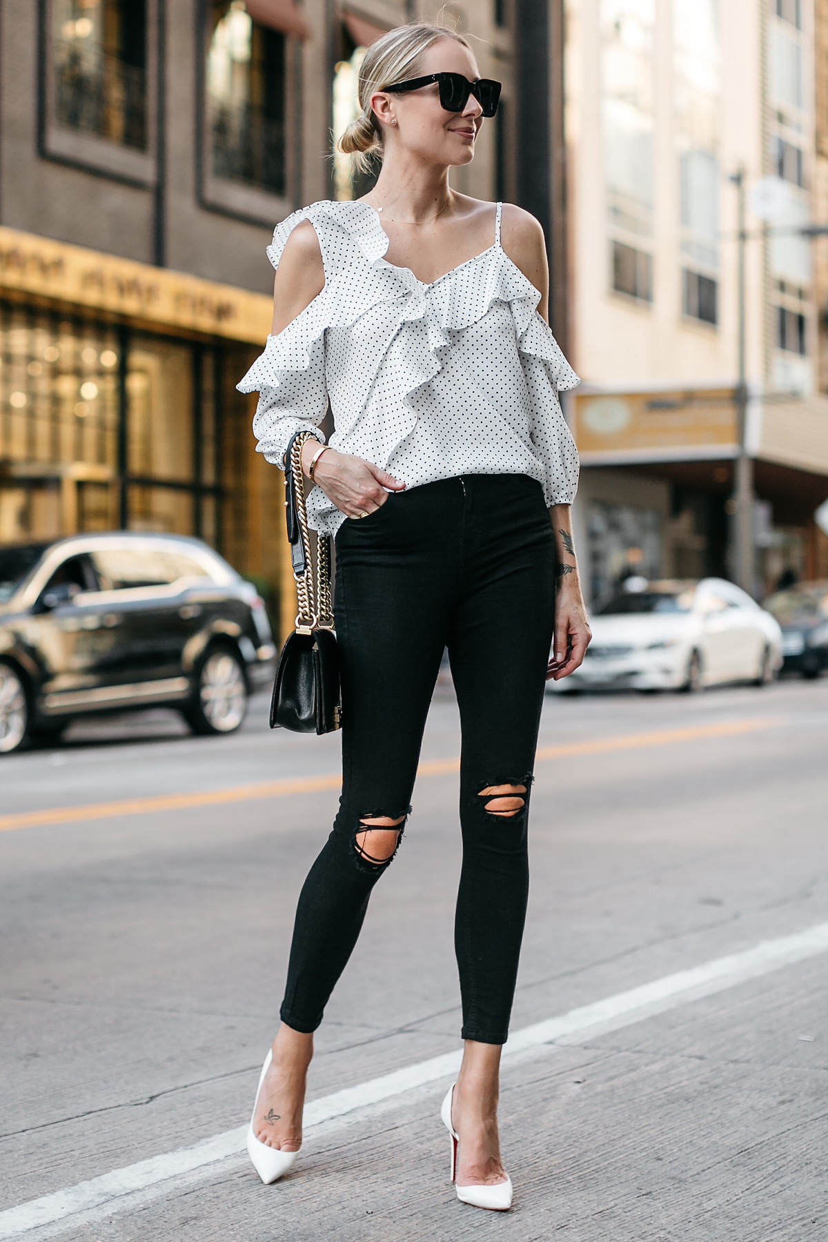 Blonde Woman Wearing Bloomingdales Black Polka Dot White Ruffle Blouse Black Ripped Denim Skinny Jeans White Pumps Fashion Jackson Dallas Blogger Fashion Blogger Street Style