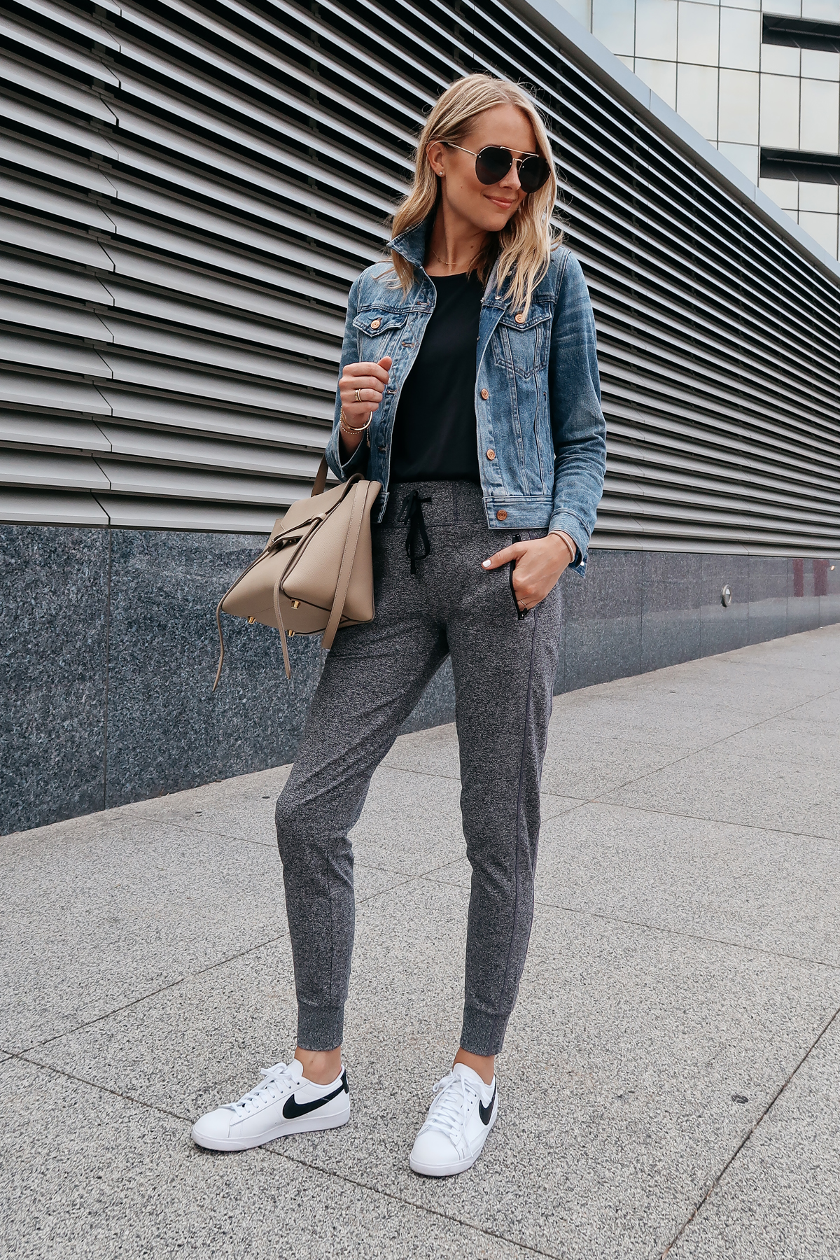 553b6896c541c Blonde Woman Wearing Jcrew Denim Jacket Black Tank Nordstrom Anniversary  Sale Grey Joggers Nike Blazer Sneakers