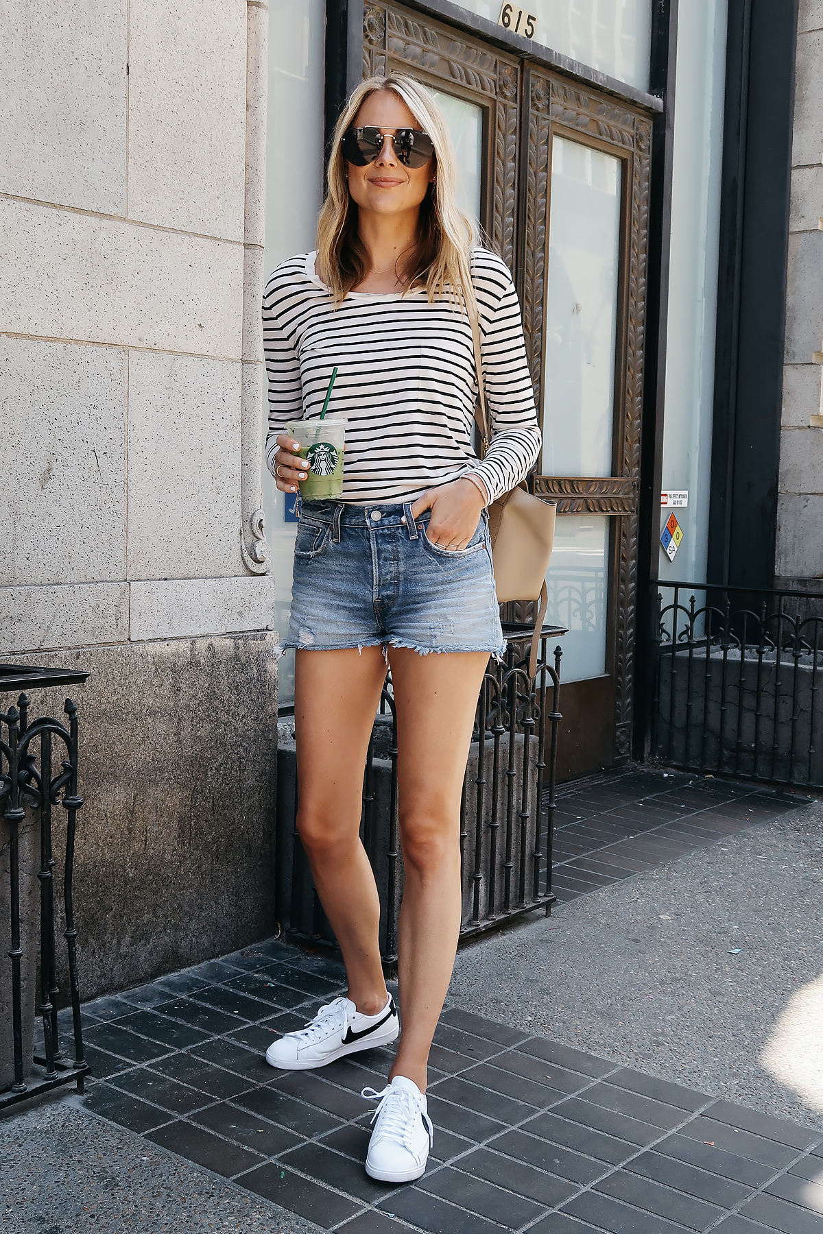 Blonde Woman Wearing Nordstrom Anniversary Sale BP Black White Stripe Long Sleeve Tshirt Levis Wedgie Denim Shorts White Nike Blazer Sneakers Quay Aviator Sunglasses Fashion Jackson San Diego Blogger Fashion Blogger Street Style