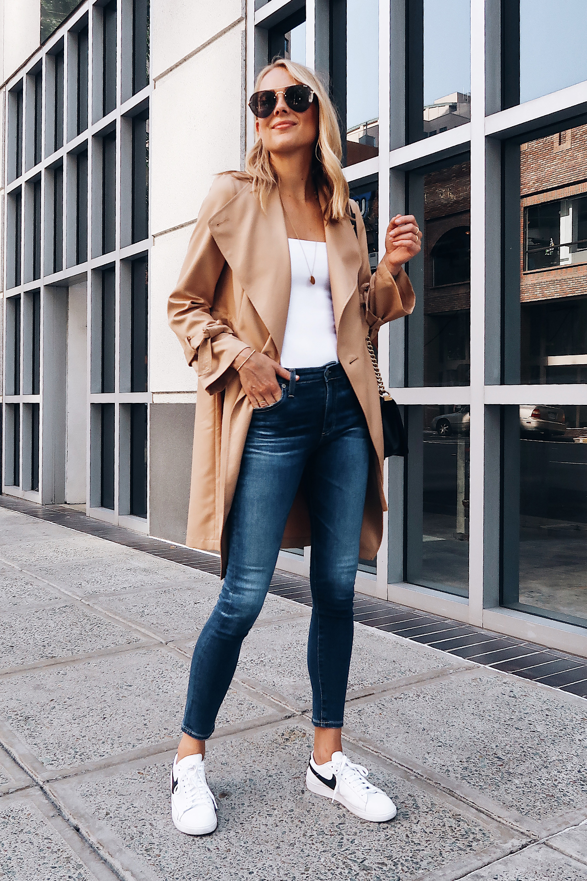Blonde Woman Wearing Nordstrom Anniversary Sale Halogen Trench Coat White Bodysuit AG Farrah Ankle Skinny Jeans Nike Blazer White Sneakers Fashion Jackson San Diego Blogger Fashion Blogger Street Style