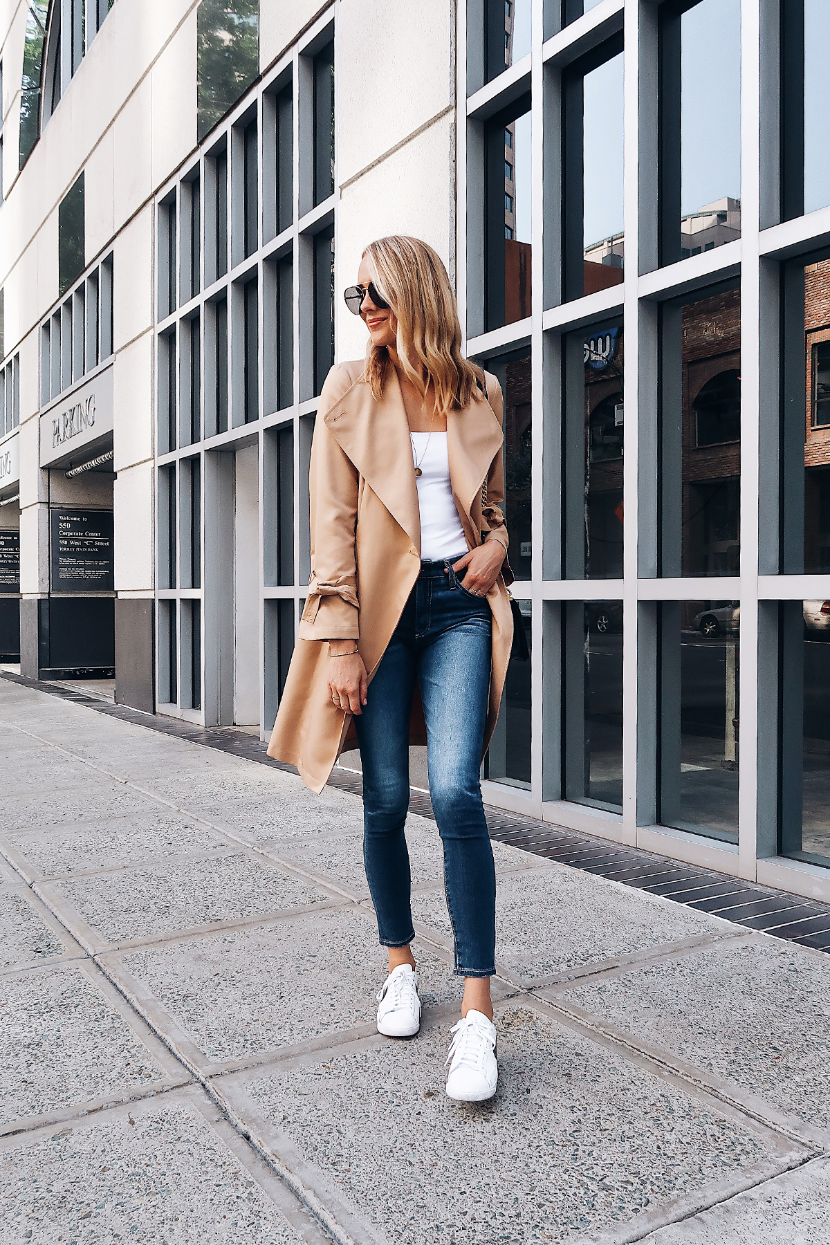 Blonde Woman Wearing Nordstrom Anniversary Sale Halogen Trench Coat White Bodysuit AG Farrah Ankle Skinny Jeans Nike Blazer White Sneakers Aviator Sunglasses Fashion Jackson San Diego Blogger Fashion Blogger Street Style