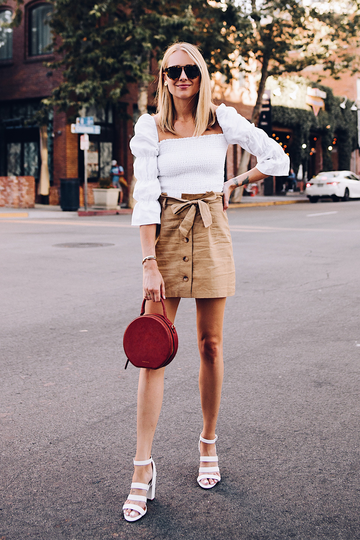 Blonde Woman Wearing Reformation White Smocked Blouse Topshop Khaki Button Front Skirt White Triple Strap Heeled Sandals Karen Walker Harvest Sunglasses Mansur Gavriel Tan Circle Handbag Fashion Jackson San Diego Blogger Fashion Blogger Street Style