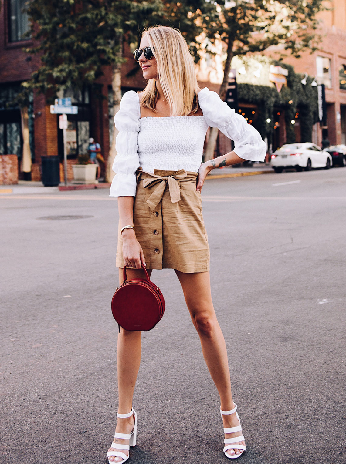 Blonde Woman Wearing Reformation White Smocked Blouse Topshop Khaki Button Front Skirt White Triple Strap Heeled Sandals Mansur Gavriel Tan Circle Handbag Fashion Jackson San Diego Blogger Fashion Blogger Street Style