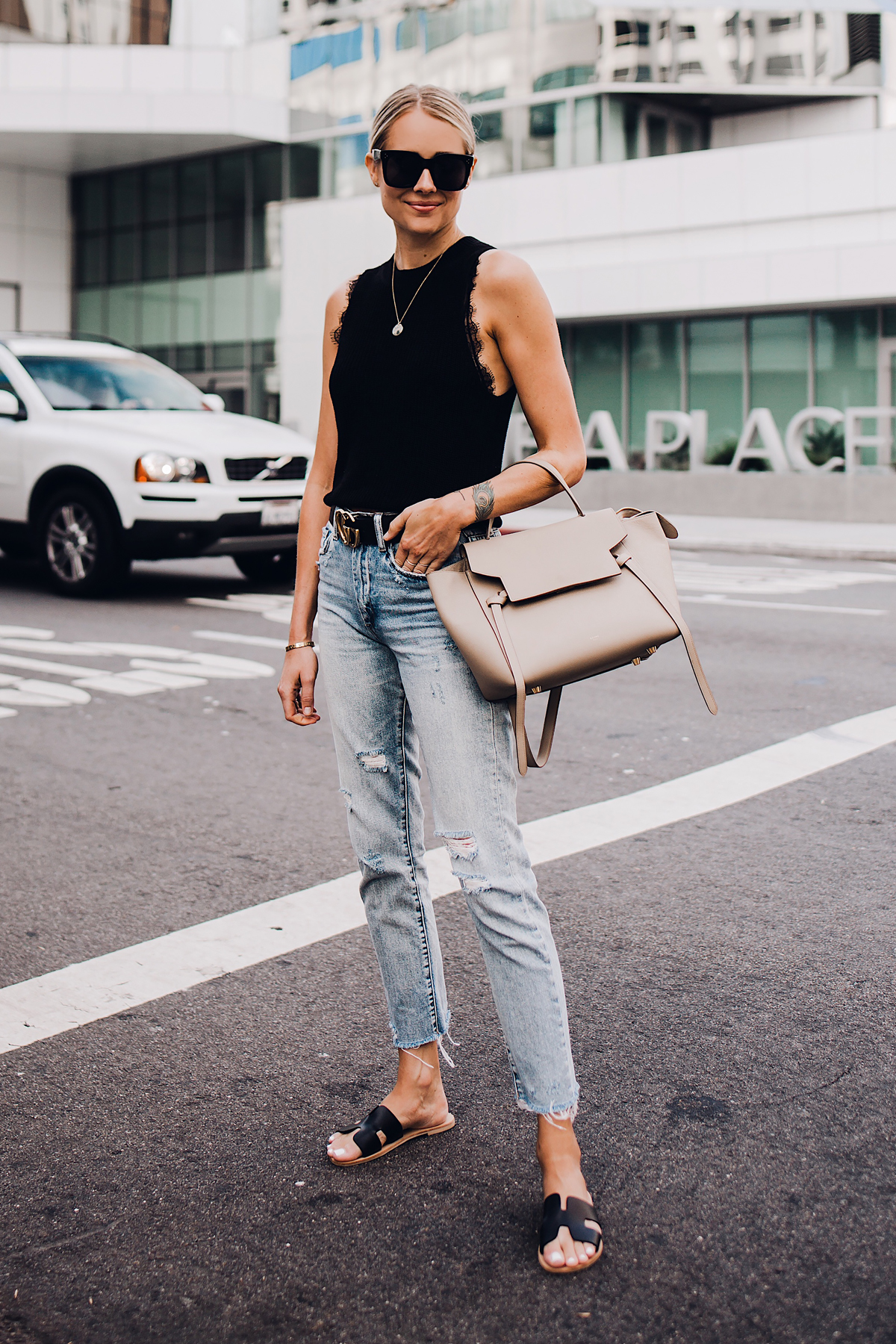 Blonde Woman Wearing Black Sweater Tank Lace Bralette Gucci Logo Belt Ripped Denim Jeans Black Steven Greece Sandals Celine Mini Belt Bag Fashion Jackson San Diego Fashion Blogger Street Style