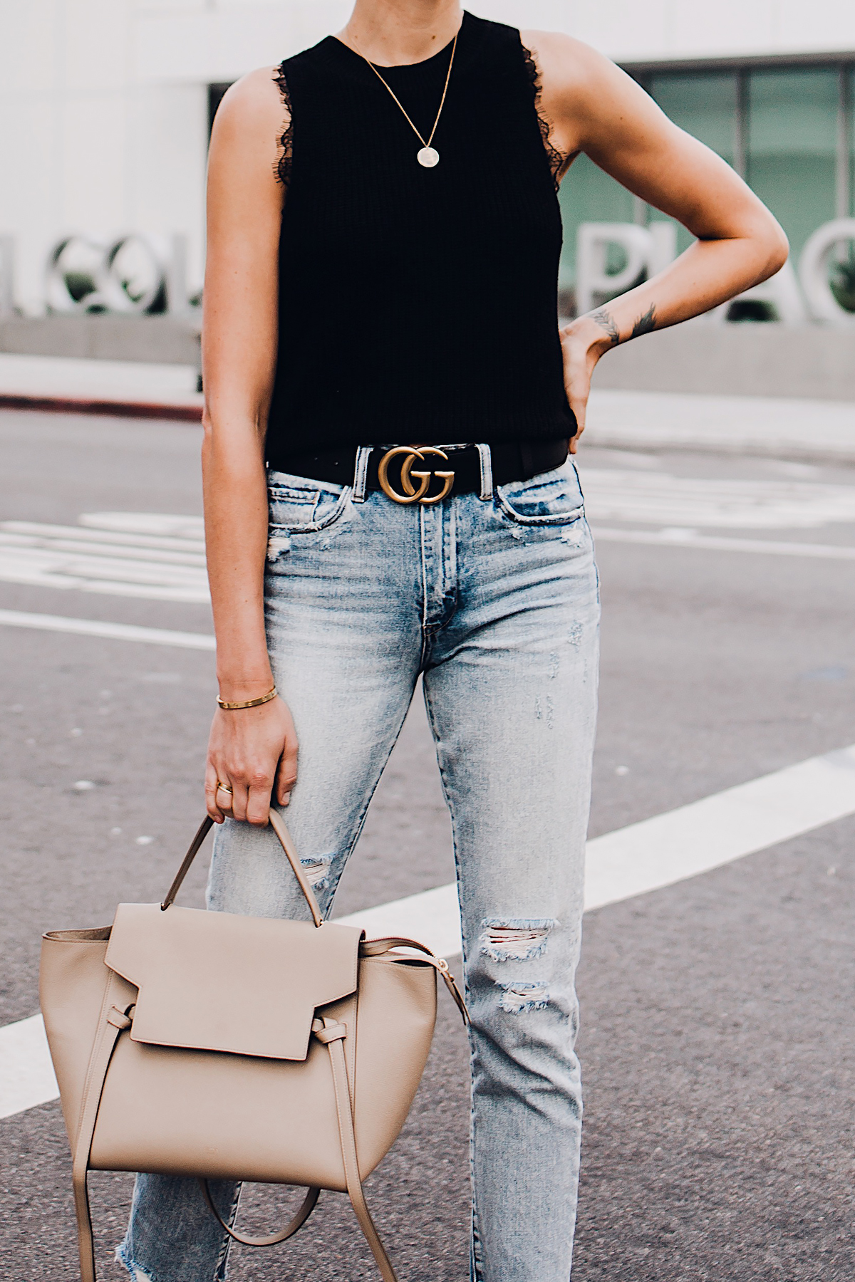 Woman Wearing Black Sweater Tank Lace Bralette Gucci Logo Belt Ripped Jeans Celine Mini Belt Bag Fashion Jackson San Diego Fashion Blogger Street Style