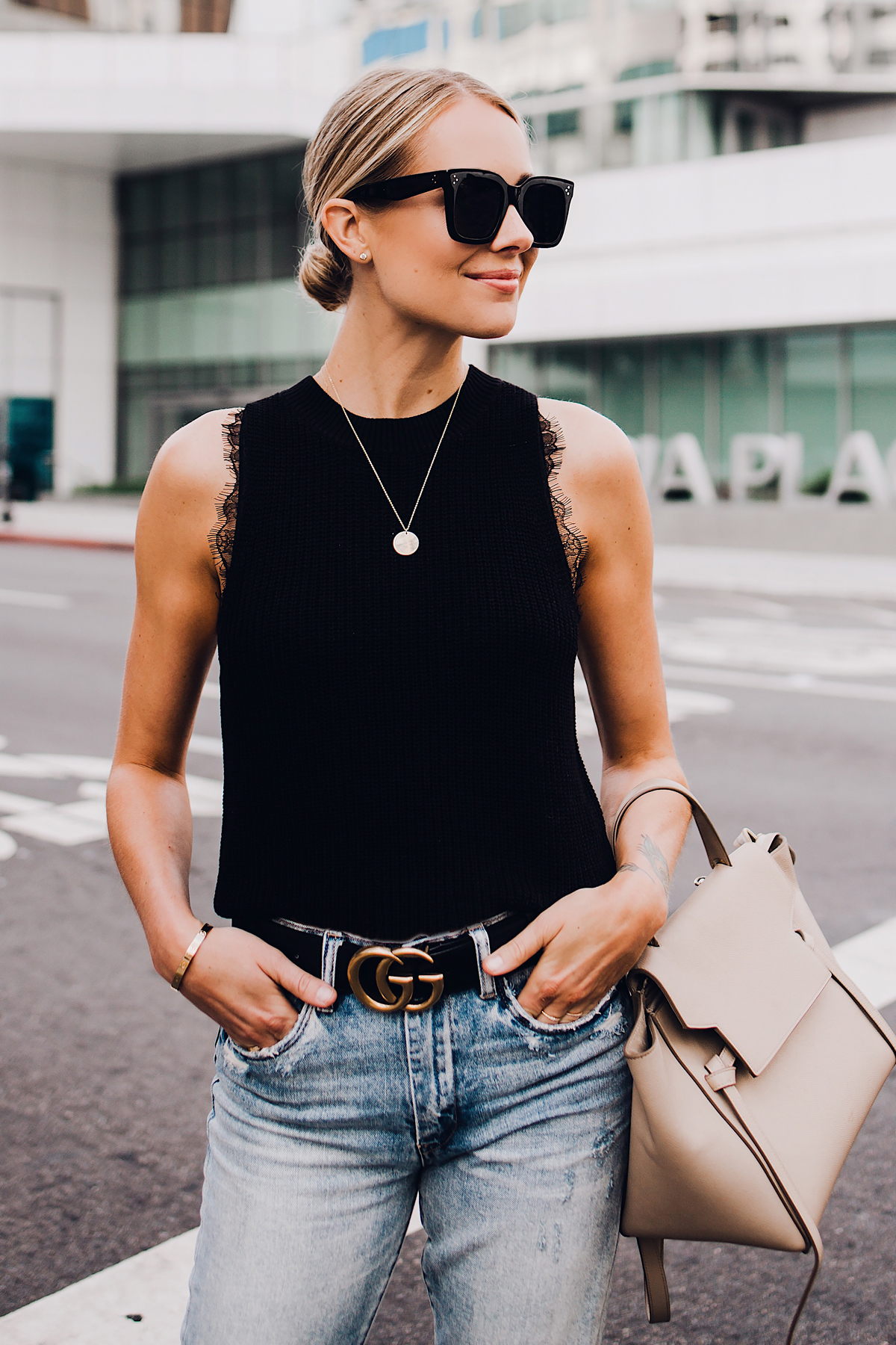 Blonde Woman Wearing Black Sweater Tank Lace Bralette Gucci Logo Belt Ripped Jeans Celine Mini Belt Bag Fashion Jackson San Diego Fashion Blogger Street Style