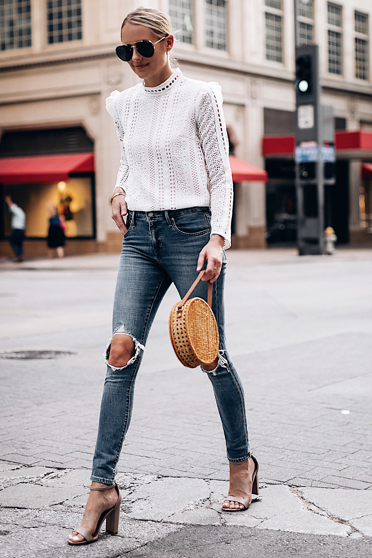 Blonde Woman Wearing Fashion Jackson Bloomingdales AQUA White Lace Ruffle Top Levis 721 Ripped Skinny Jeans Tan Ankle Strap Heeled Sandals Serpui Straw Circle Handbag Aviator Sunglasses Fashion Jackson San Diego Fashion Blogger Street Style