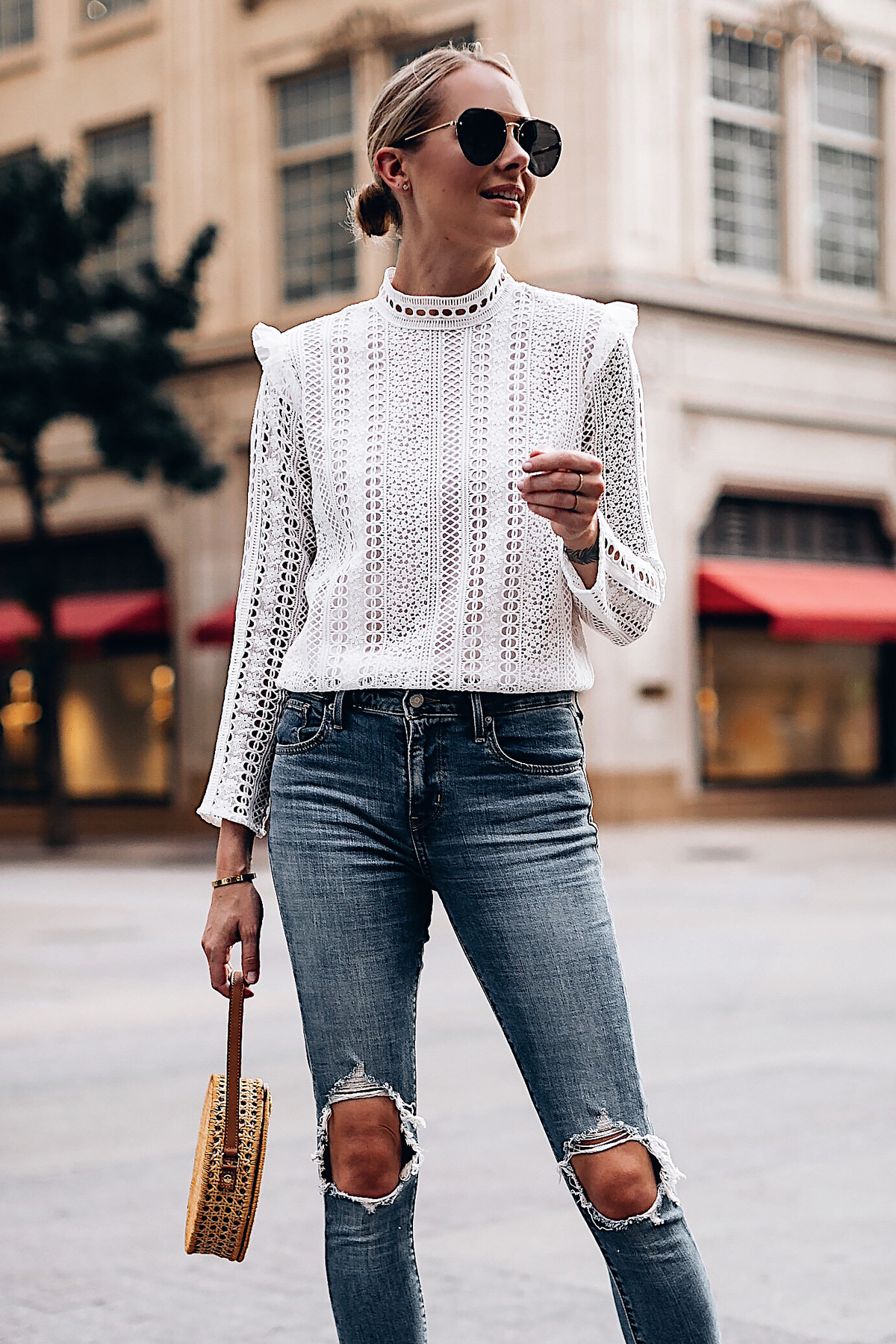 Blonde Woman Wearing Fashion Jackson Bloomingdales AQUA White Lace Ruffle Top Levis 721 Skinny Jeans Serpui Straw Circle Handbag Quay Aviator Sunglasses Fashion Jackson San Diego Fashion Blogger Street Style