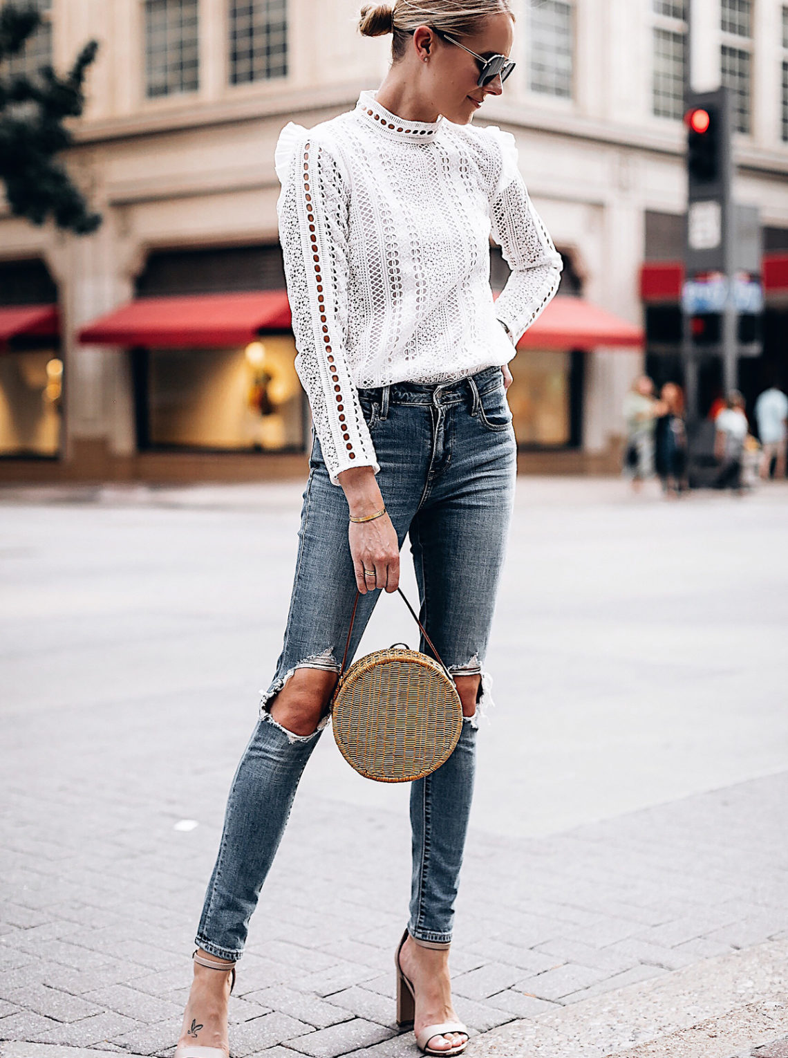 Blonde Woman Wearing Fashion Jackson Bloomingdales AQUA White Lace Ruffle Top Levis 721 Skinny Jeans Tan Ankle Strap Heeled Sandals Serpui Straw Circle Handbag Fashion Jackson San Diego Fashion Blogger Street Style