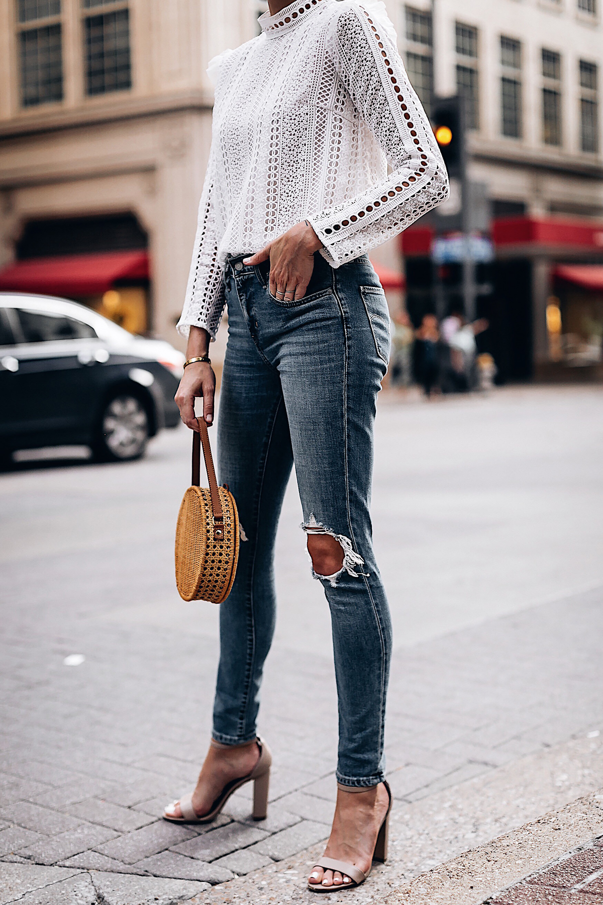 Woman Wearing Fashion Jackson Bloomingdales AQUA White Lace Ruffle Top Levis 721 Skinny Jeans Tan Ankle Strap Heeled Sandals Serpui Straw Circle Handbag Fashion Jackson San Diego Fashion Blogger Street Style