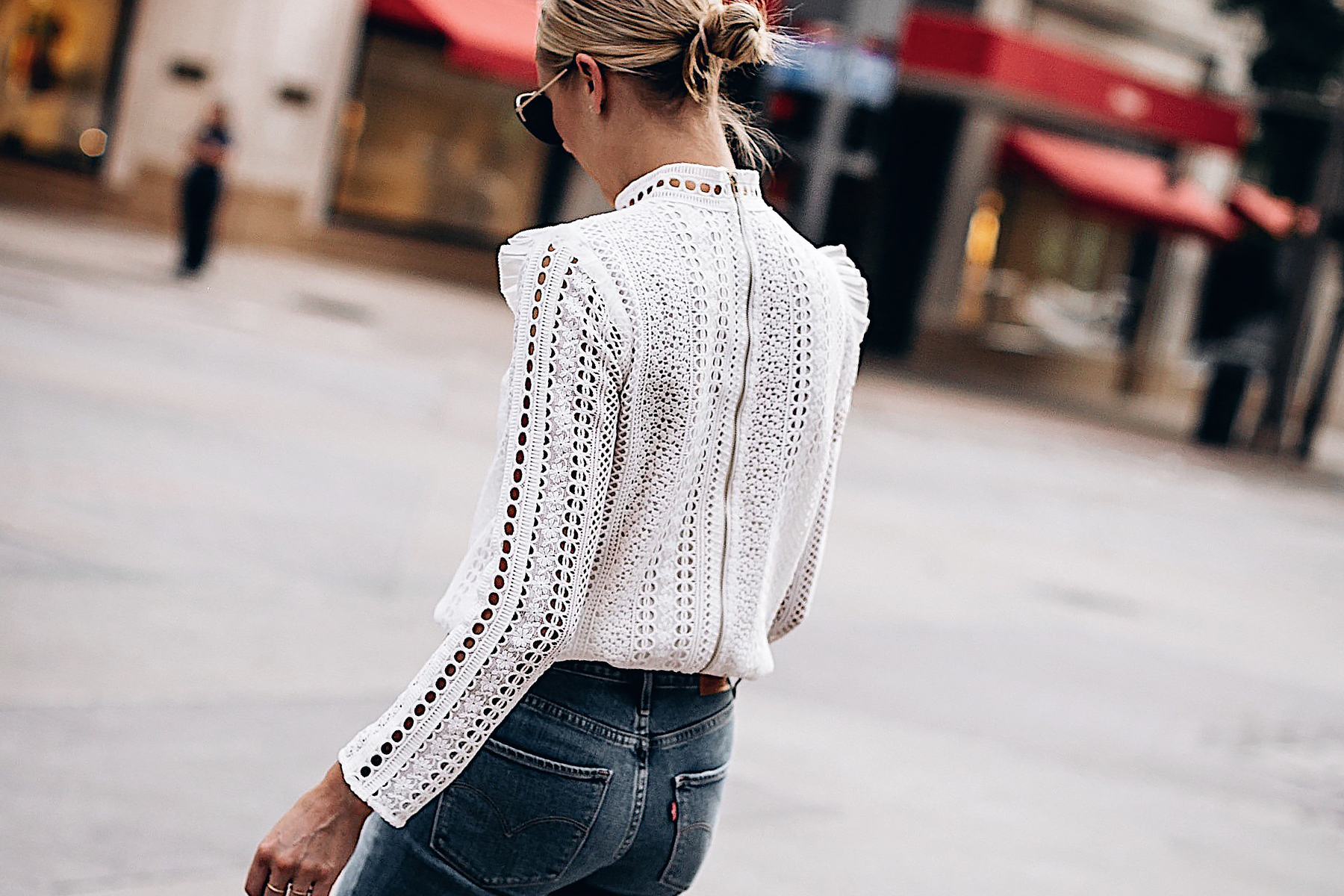 Blonde Woman Wearing Fashion Jackson Bloomingdales AQUA White Lace Ruffle Top Levis 721 Skinny Jeans Fashion Jackson San Diego Fashion Blogger Street Style