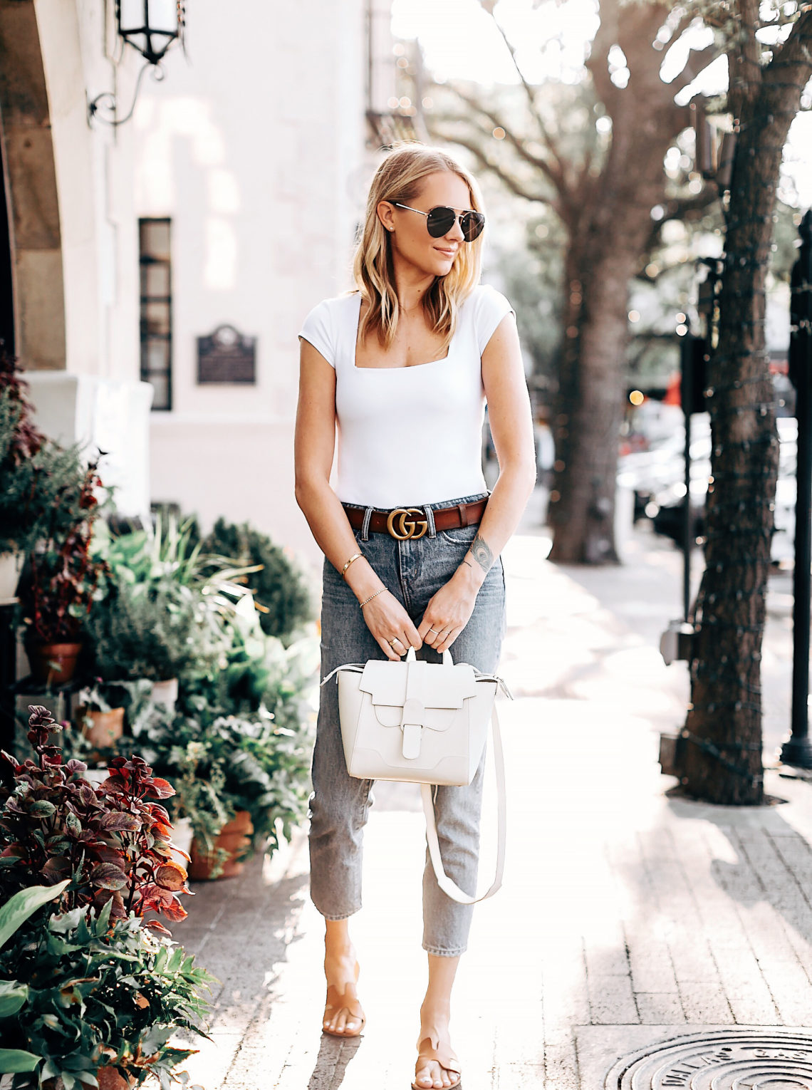 Blonde Woman Wearing Free People White Bodysuit Cropped Denim Ripped Jeans Senreve Mini Maestra Cream Gucci Brown Leather Double G Belt Steven Greece Slides Aviator Sunglasses Fashion Jackson San Diego Fashion Blogger Street Style