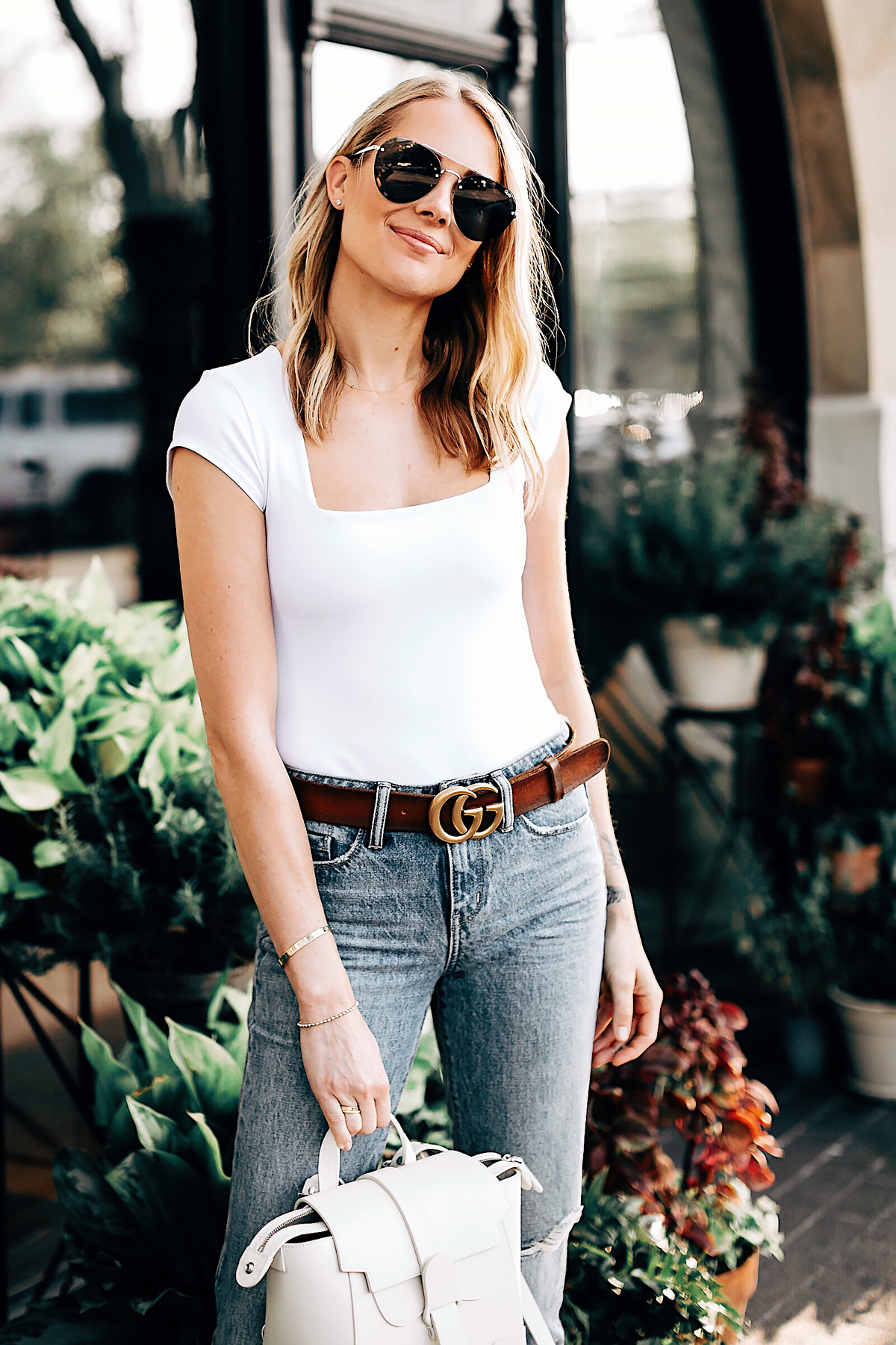 Blonde Woman Wearing Free People White Bodysuit Ripped Jeans Senreve Mini Maestra Cream Gucci Brown Leather Double G Belt Aviator Sunglasses Fashion Jackson San Diego Fashion Blogger Street Style