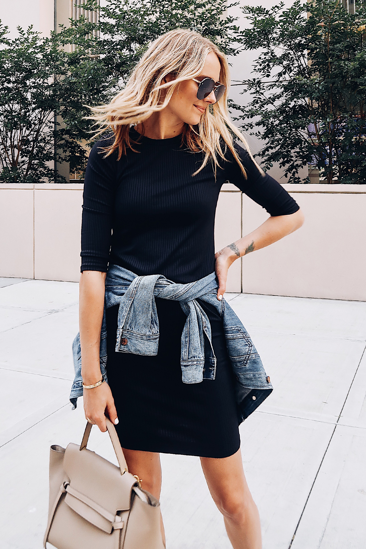 9256d3e44c92e Blonde Woman Wearing Little Black Dress Denim Jacket Celine Mini Belt Bag  Aviator Sunglasses Fashion Jackson