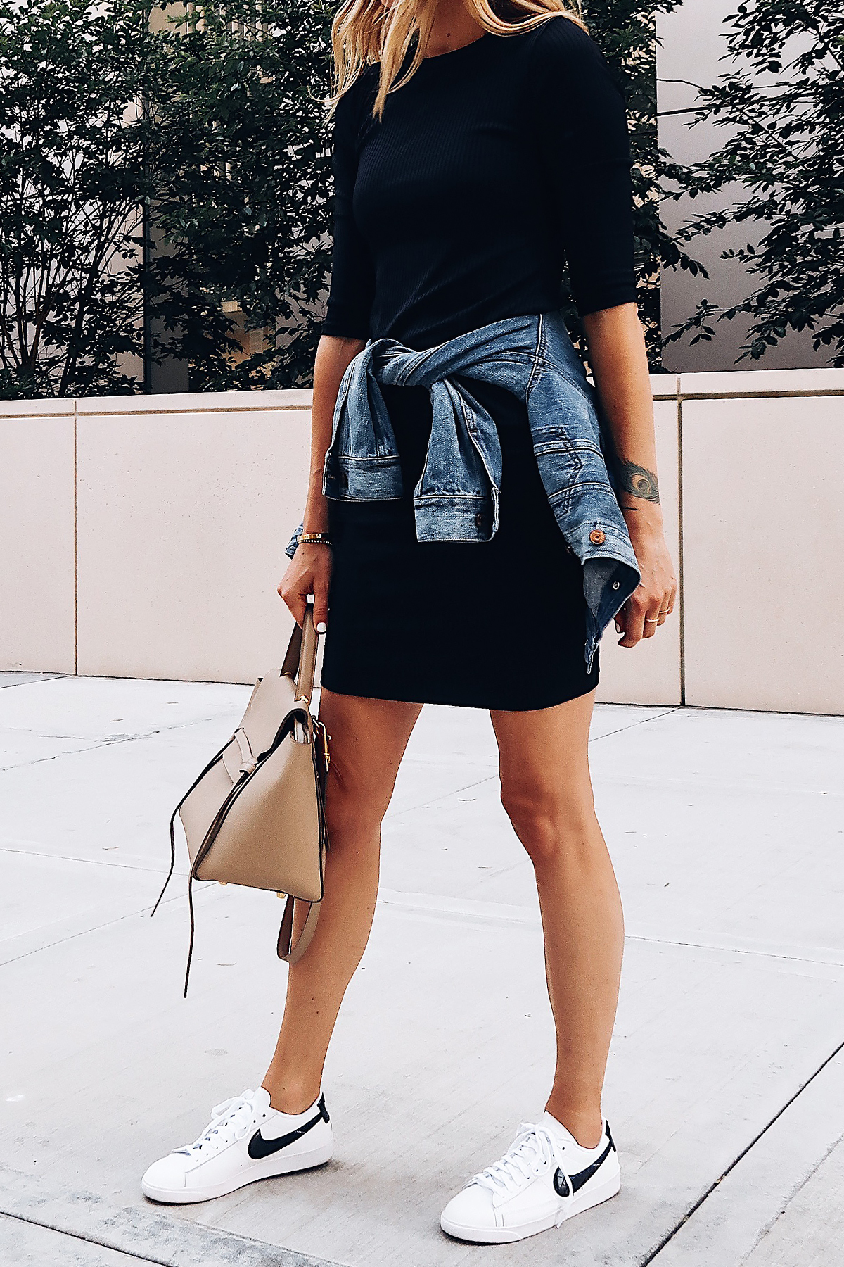 Woman Wearing Little Black Dress Denim Jacket White Nike Blazer Sneakers Celine Mini Belt Bag Fashion Jackson San Diego Blogger Fashion Blogger Street Style