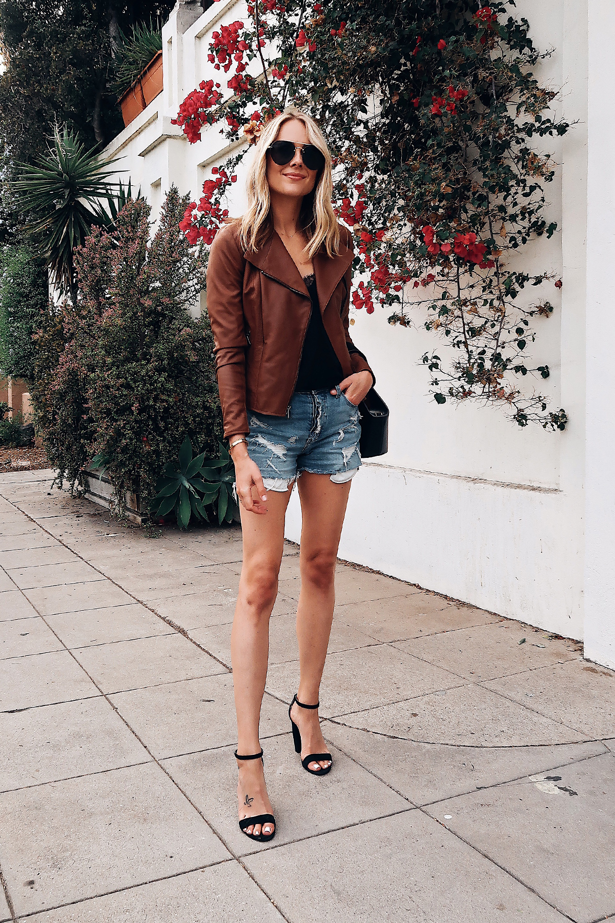 Blonde Woman Wearing Nordstrom Anniversary Sale Tan Leather Jacket Black Lace Cami Denim Ripped Shorts Black Ankle Strap Heels Aviator Sunglasses Fashion Jackson San Diego Blogger Fashion Blogger Street Style