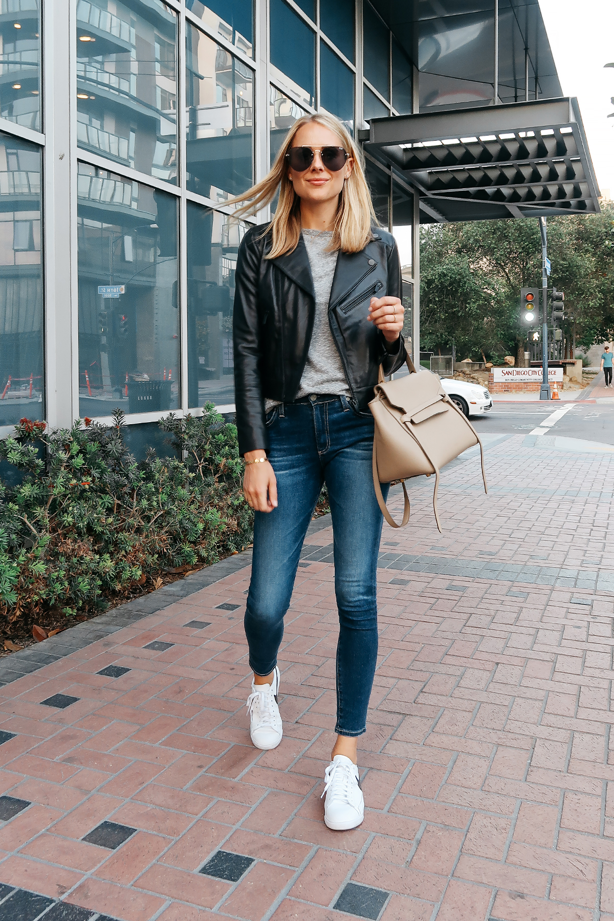Blonde Woman Wearing Nordstrom Anniversray Sale Black Leather Jacket Grey Tshirt Denim Skinny Jeans Nike Sneakers Celine Mini Belt Bag Aviator Sunglasses Fashion Jackson San Diego Blogger Fashion Blogger Street Style