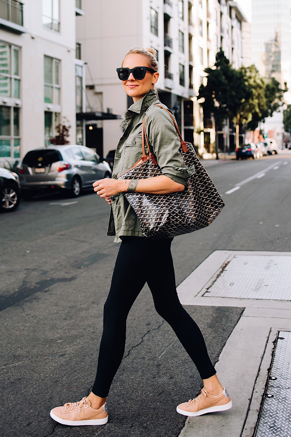 Blonde Woman Wearing Nordstrom Green Utility Jacket Black Leggings Nike Sneakers Beige Goyard Large Tote Fashion Jackson San Diego Fashion Blogger Street Style