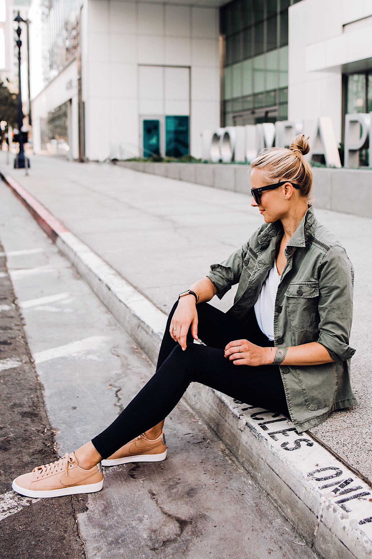 Blonde Woman Wearing Nordstrom Green Utility Jacket White Tshirt Black Leggings Nike Sneakers Beige Fashion Jackson San Diego Fashion Blogger Street Style
