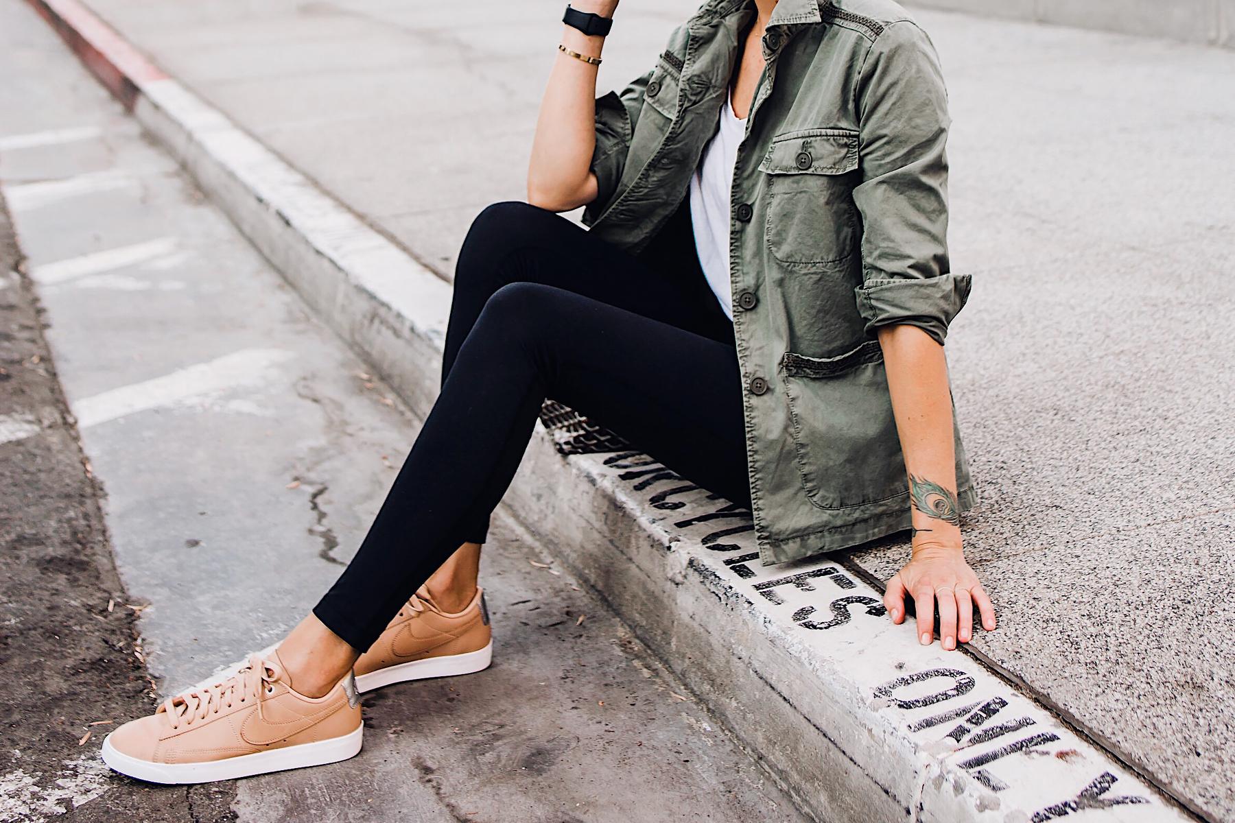 Woman Wearing Fashion Jackson Nordstrom Green Utility Jacket White Tshirt Black Leggings Nike Sneakers Beige Fashion Jackson San Diego Fashion Blogger Street Style