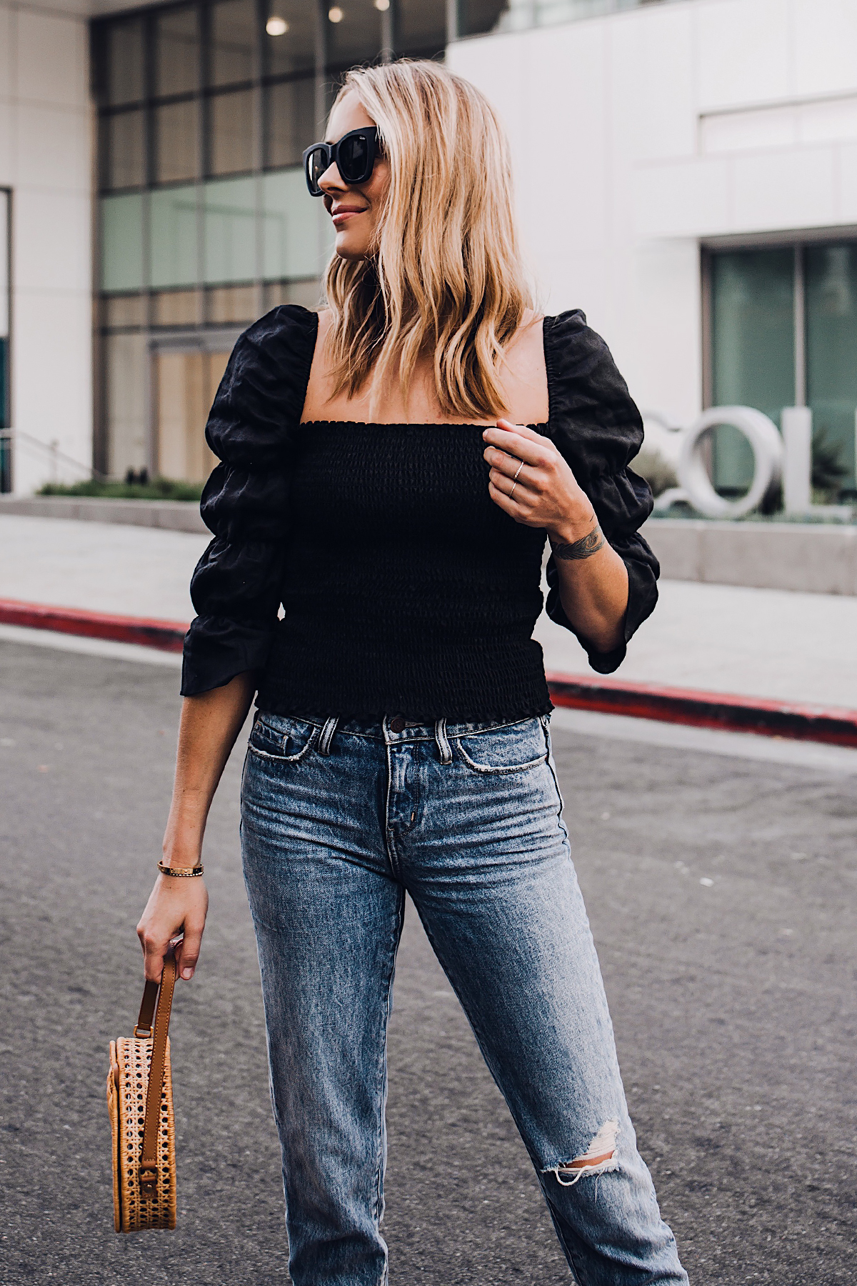 Blonde Woman Wearing Fashion Jackson Reformation Gala Top Black Ripped Jeans Cane Circle Straw Handbag Black Sunglasses Fashion Jackson San Diego Fashion Blogger Street Style