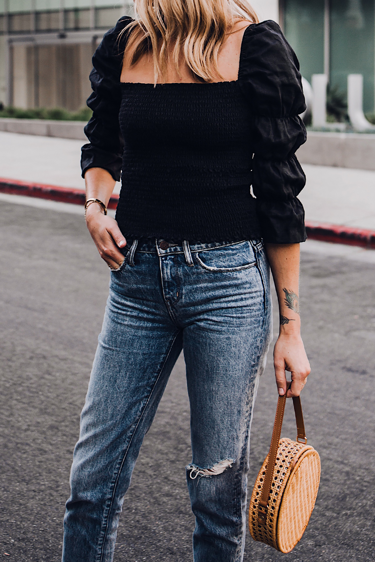 Blonde Woman Wearing Fashion Jackson Reformation Gala Top Black Ripped Jeans Cane Circle Straw Handbag Fashion Jackson San Diego Fashion Blogger Street Style