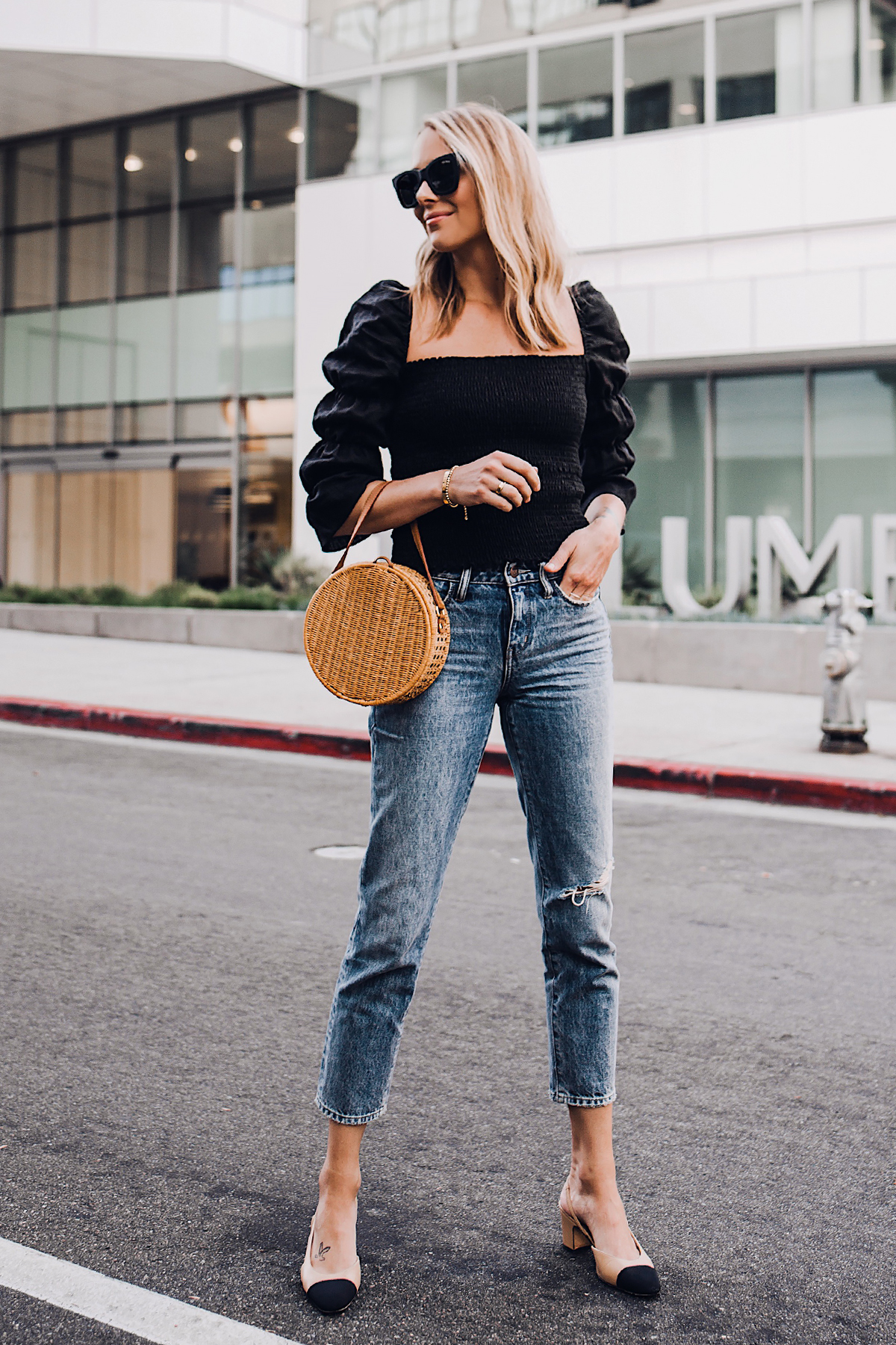 Blonde Woman Wearing Fashion Jackson Reformation Gala Top Black Straight Leg Ripped Jeans Chanel Slingback Shoes Cane Circle Straw Handbag Black Sunglasses Fashion Jackson San Diego Fashion Blogger Street Style