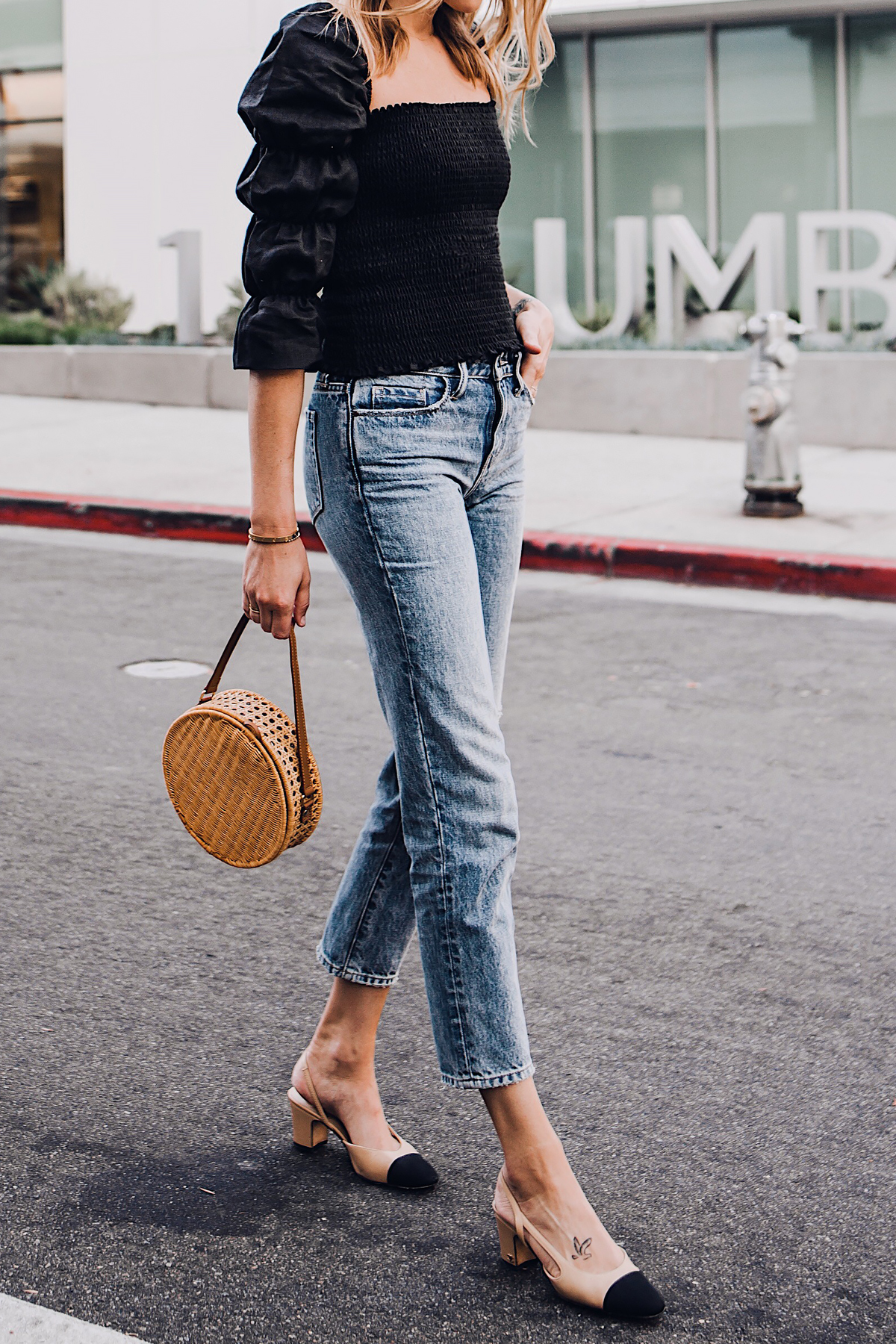 Blonde Woman Wearing Fashion Jackson Reformation Gala Top Black Straight Leg Ripped Jeans Chanel Slingback Shoes Cane Circle Straw Handbag Fashion Jackson San Diego Fashion Blogger Street Style