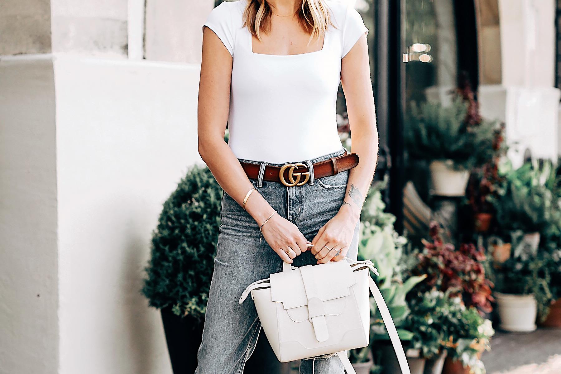 Woman Wearing Senreve Mini Maestra Cream Free People White Bodysuit Ripped Jeans Gucci Brown Leather Double G Belt Fashion Jackson San Diego Fashion Blogger Street Style