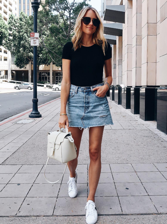 Blonde Woman Wearing Short Sleeve Black Bodysuit Levis Denim Skirt Nike White Sneakers Senreve White Mini Maestra Aviator Sunglasses Fashion Jackson San Diego Fashion Blogger Street Style