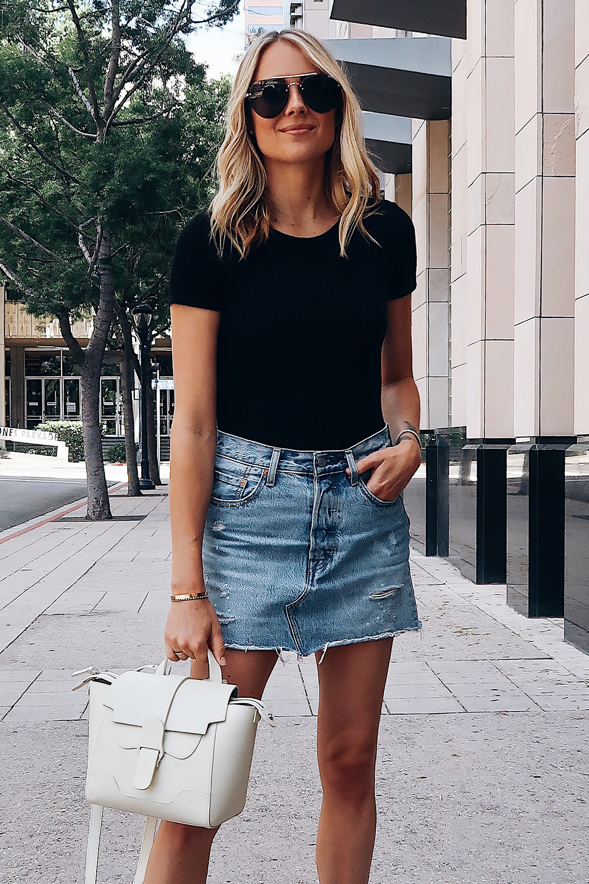 Blonde Woman Wearing Short Sleeve Black Bodysuit Levis Denim Skirt Senreve White Mini Maestra Handbag Aviator Sunglasses Fashion Jackson San Diego Fashion Blogger Street Style