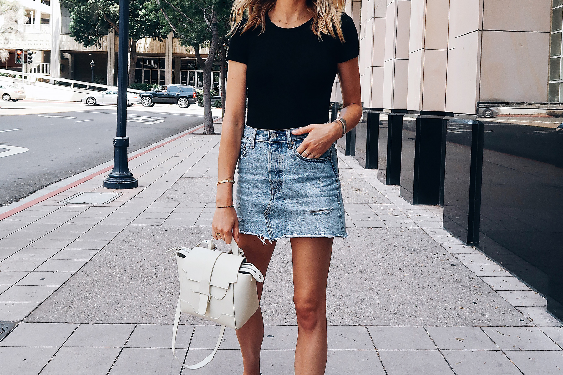 Blonde Woman Wearing Short Sleeve Black Bodysuit Levis Denim Skirt Senreve White Mini Maestra Handbag Fashion Jackson San Diego Fashion Blogger Street Style