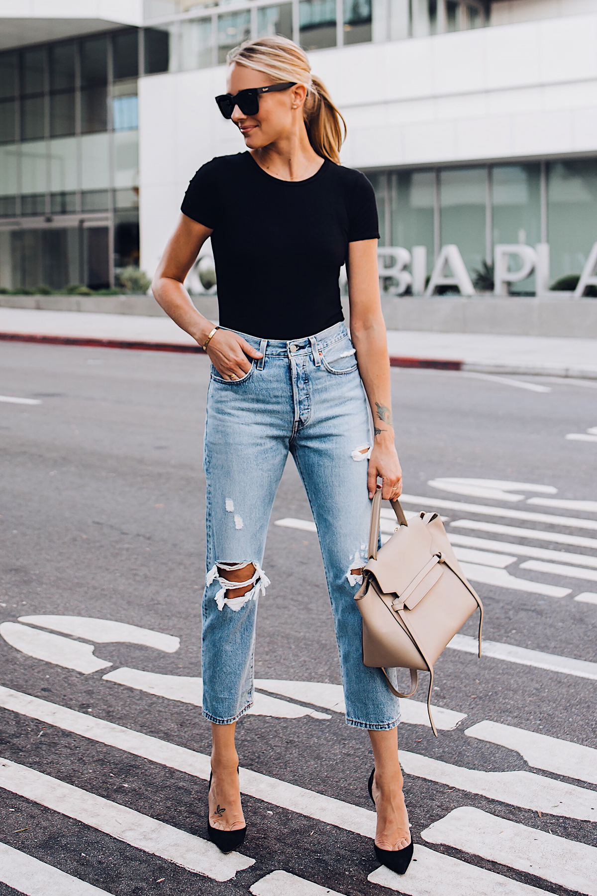 Blonde Woman Wearing Short Sleeve Black Bodysuit Levis Wedgie Straight Leg Ripped Jeans Black Pumps Celine Mini Belt Bag Fashion Jackson San Diego Fashion Blogger Street Style