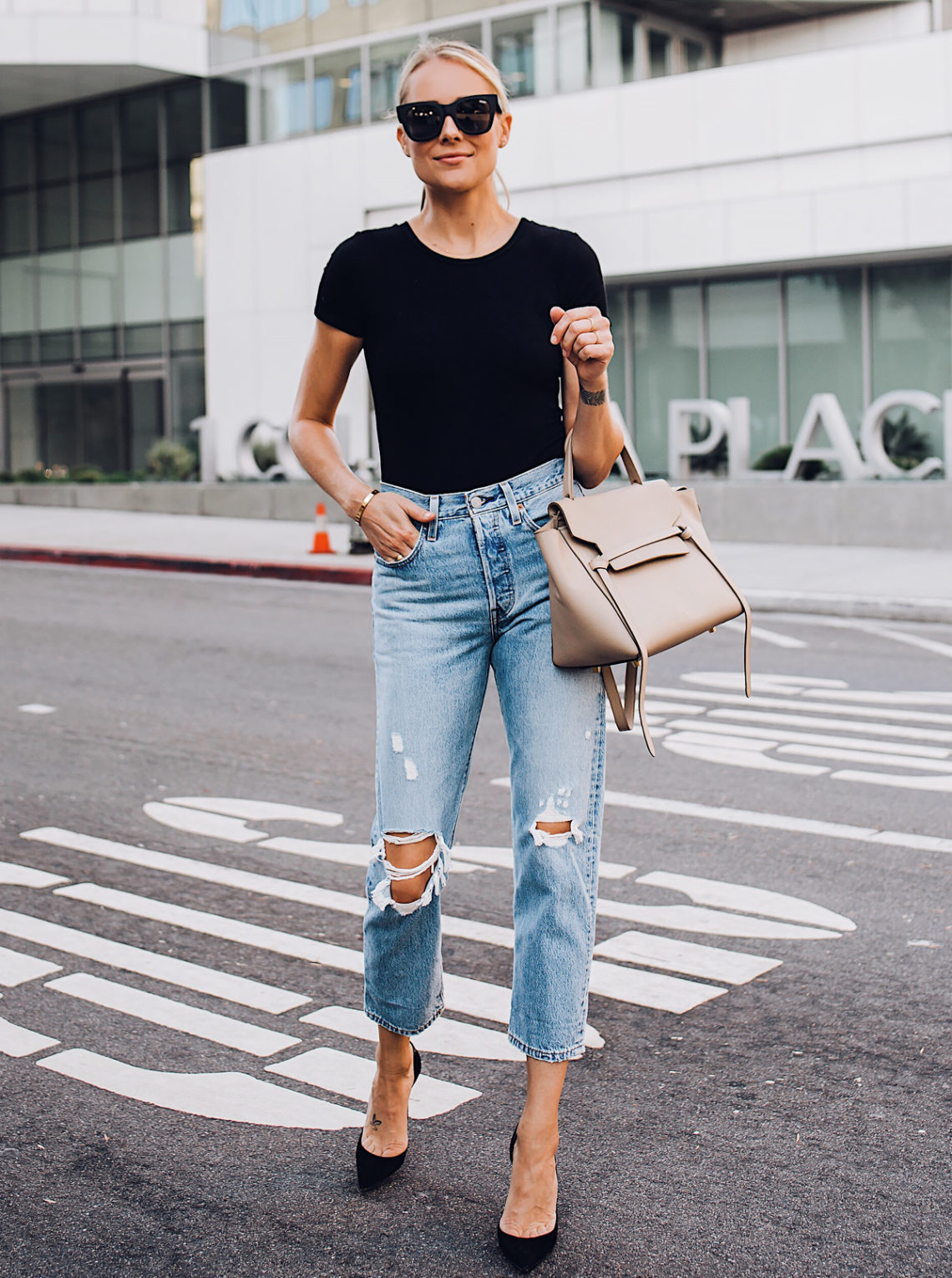 3a26571ee597d 9 Pairs of Ripped Jeans Under $100 · Blonde Woman Wearing Little Black  Dress Denim Jacket White Nike Blazer Sneakers Celine Mini Belt Bag