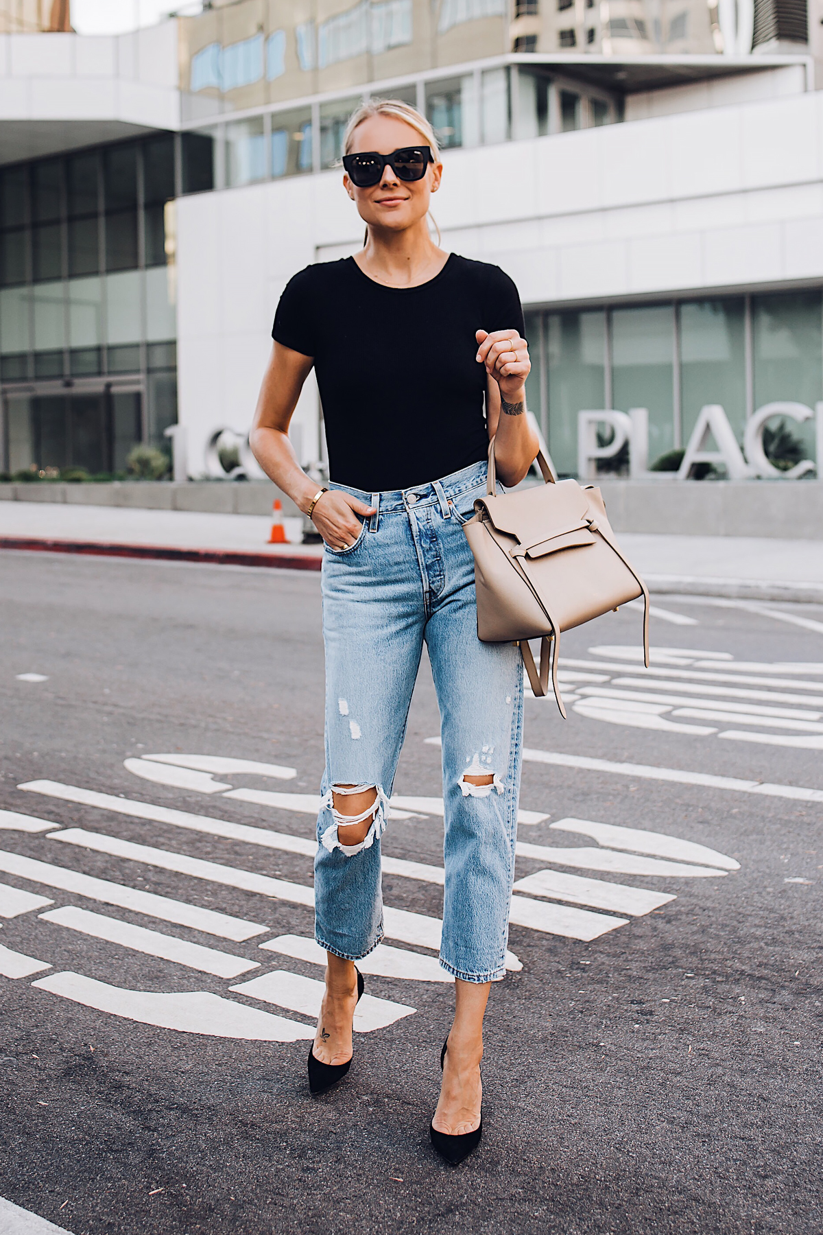 Blonde Woman Wearing Fashion Jackson Short Sleeve Black Bodysuit Levis Wedgie Straight Leg Ripped Jeans Black Pumps Celine Mini Belt Bag Fashion Jackson San Diego Blogger Fashion Blogger Street Style