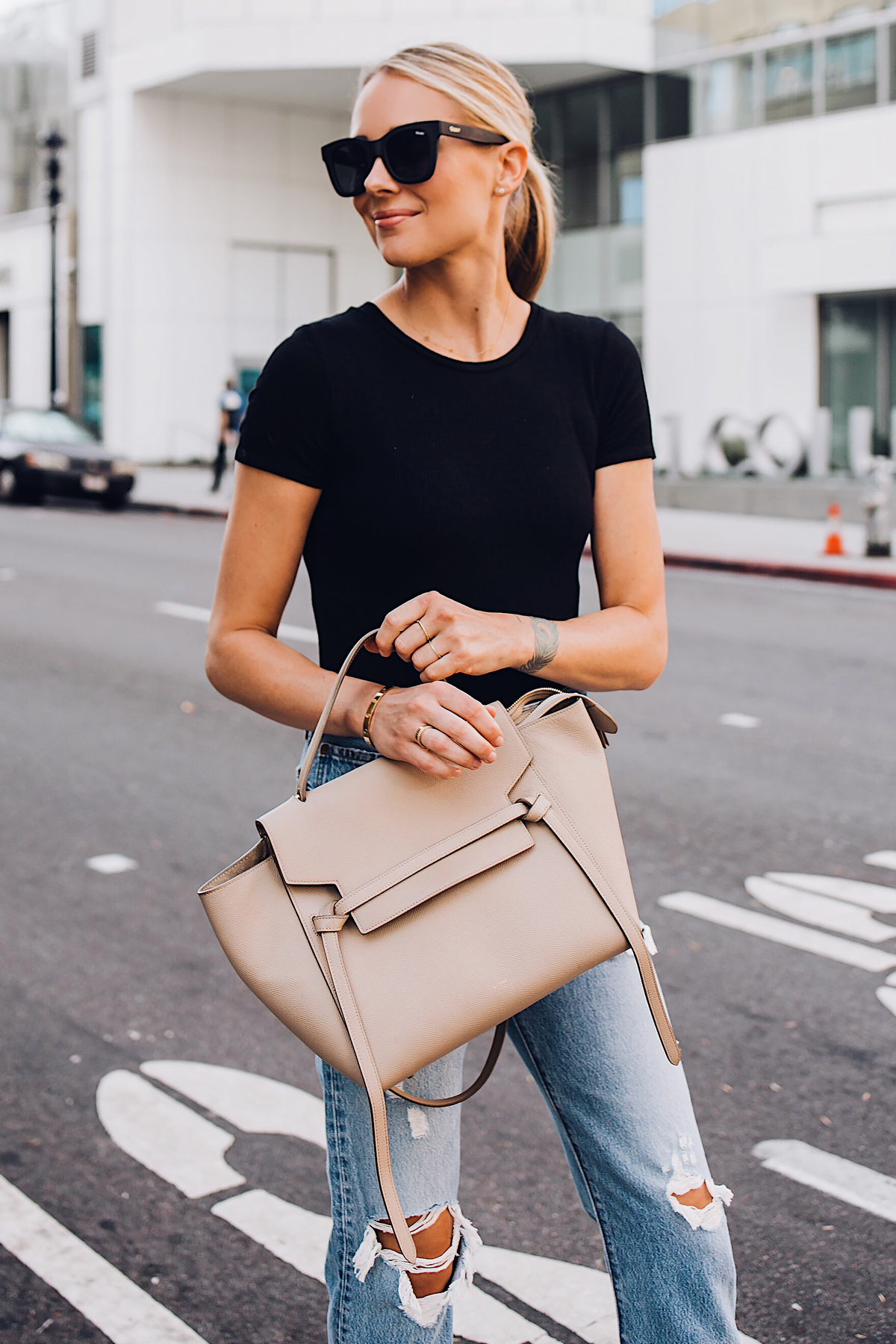 Blonde Woman Wearing Short Sleeve Black Bodysuit Levis Wedgie Straight Leg Ripped Jeans Celine Mini Belt Bag Fashion Jackson San Diego Blogger Fashion Blogger Street Style