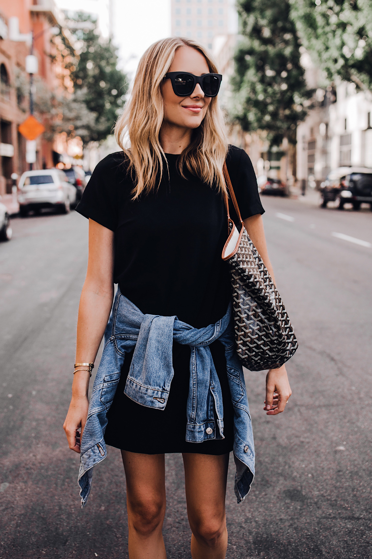 Blonde Woman Wearing Fashion Jackson Short Sleeve Black Dress Denim Jacket Goyard Tote Black Sunglasses Fashion Jackson San Diego Fashion Blogger Street Style