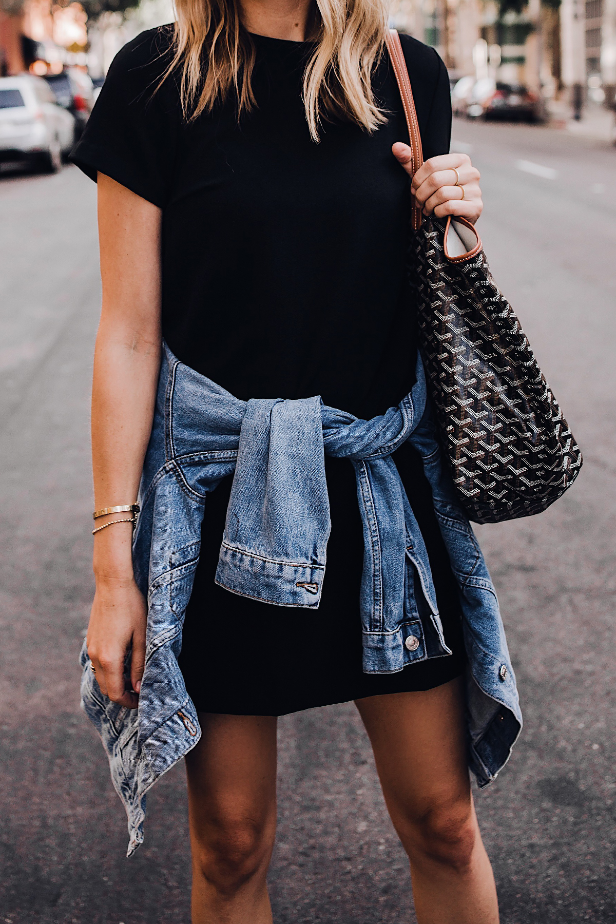 Blonde Woman Wearing Fashion Jackson Short Sleeve Black Dress Denim Jacket Goyard Tote Fashion Jackson San Diego Fashion Blogger Street Style