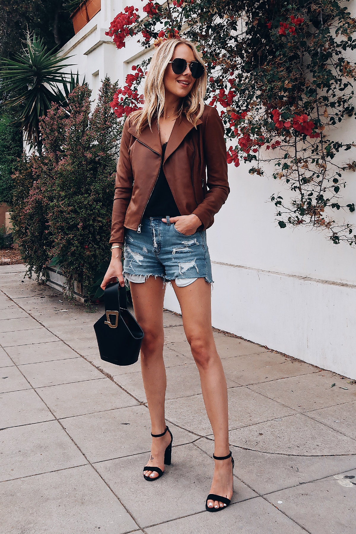 Blonde Woman Wearing Fashion Jackson Tan Leather Jacket Black Lace Cami Denim Ripped Shorts Black Ankle Strap Heeled Sandals Aviator Sunglasses Danse Lente Black Handbag Fashion Jackson San Diego Fashion Blogger Street Style