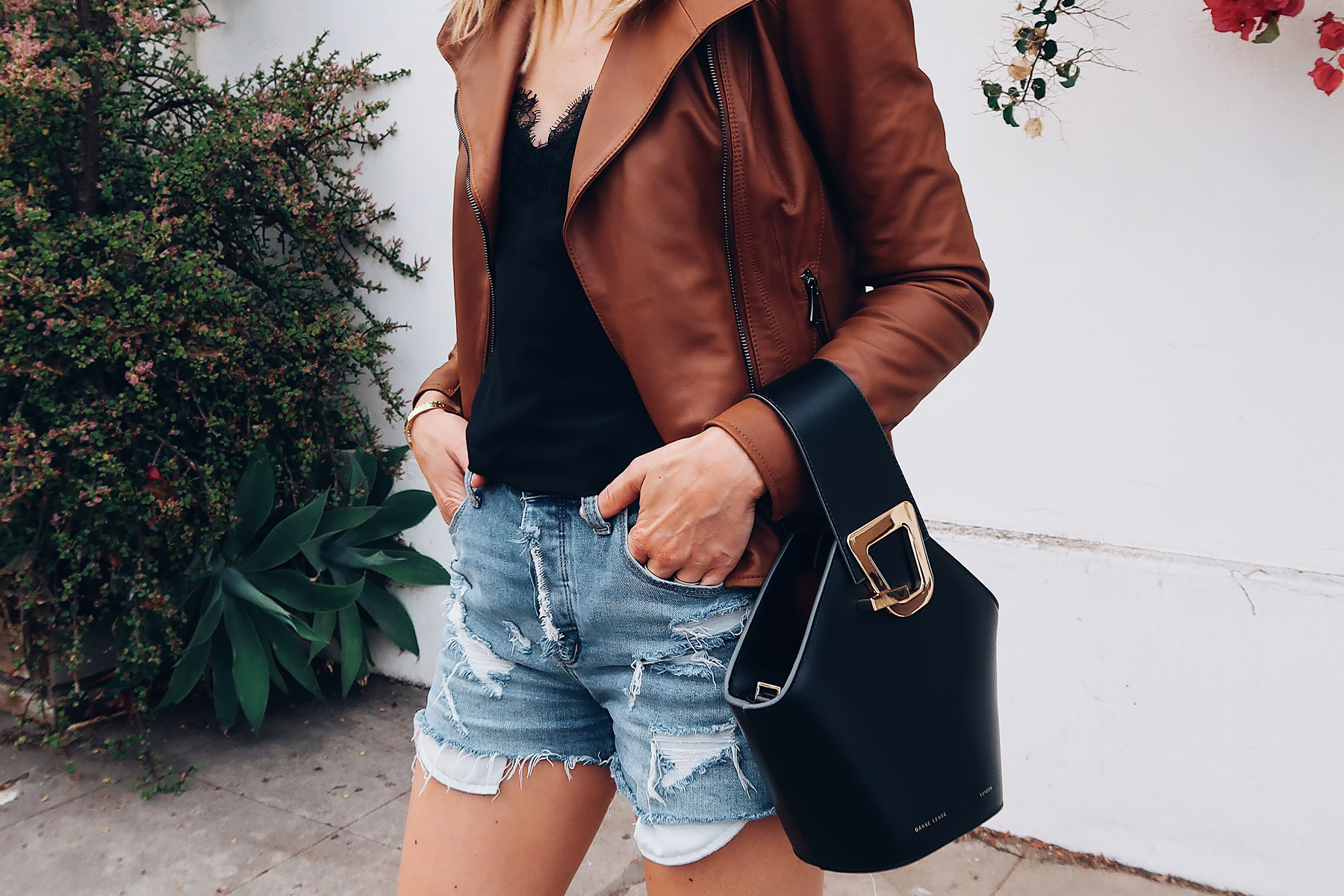 Woman Wearing Fashion Jackson Tan Leather Jacket Black Lace Cami Denim Ripped Shorts Danse Lente Black Handbag Fashion Jackson Fashion Blogger Street Style
