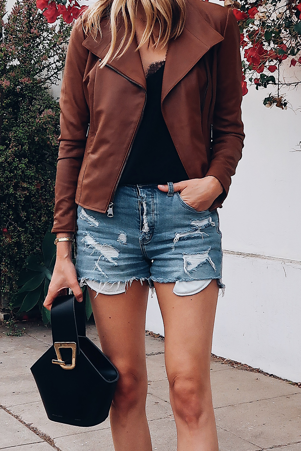 Blonde Woman Wearing Fashion Jackson Tan Leather Jacket Black Lace Cami Denim Ripped Shorts Danse Lente Black Handbag Fashion Jackson San Diego Fashion Blogger Street Style