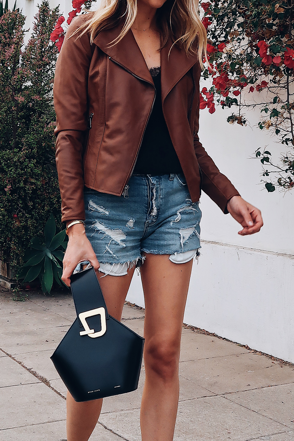 Woman Wearing Fashion Jackson Tan Leather Jacket Black Lace Cami Denim Ripped Shorts Danse Lente Black Handbag Fashion Jackson San Diego Fashion Blogger Street Style