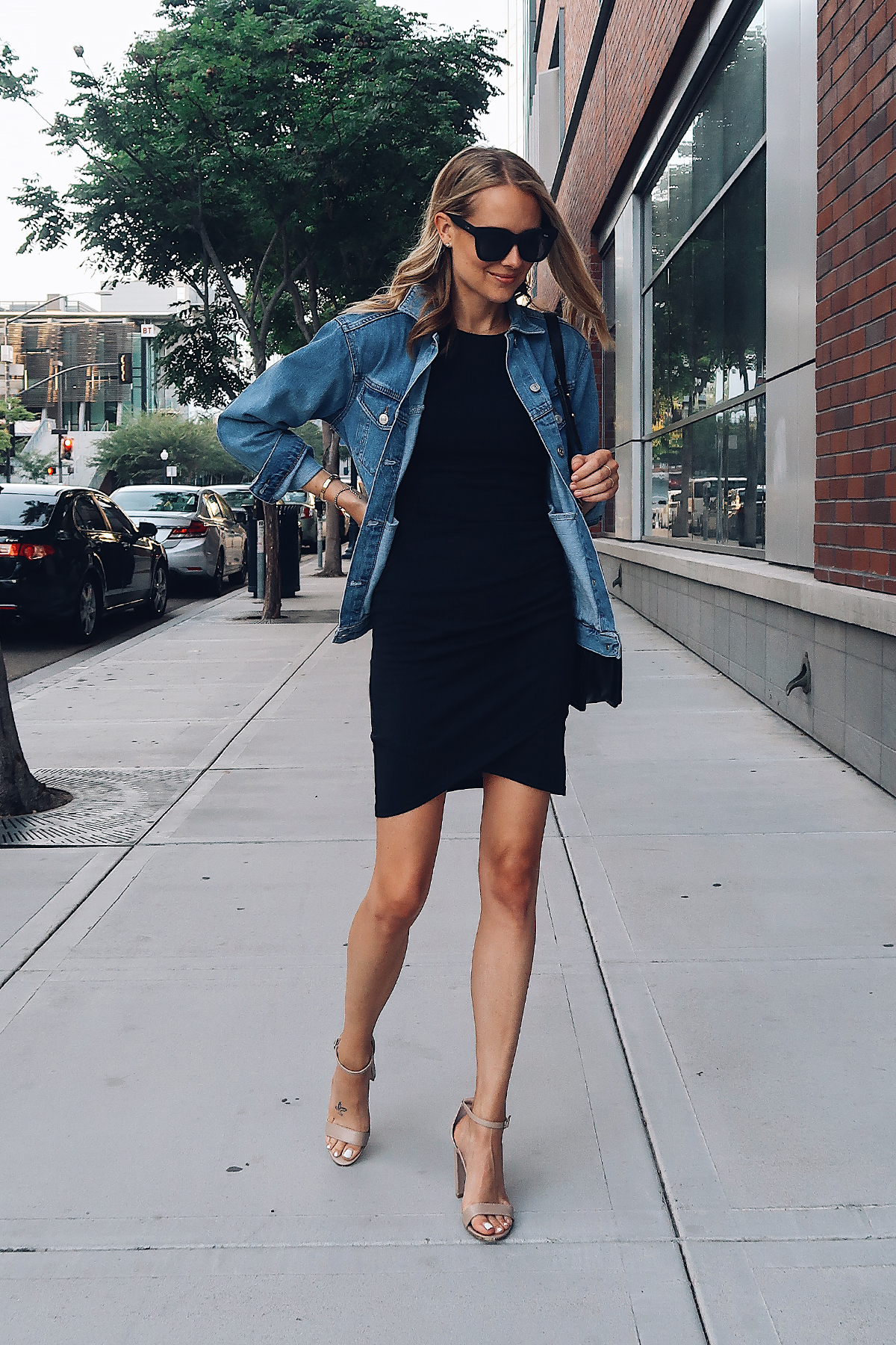 Blonde Woman Wearing Fashion Jackson Topshop Oversized Denim Jacket Black Wrap Dress Steve Madden Nude Ankle Strap Heeled Sandals Fashion Jackson San Diego Fashion Blogger Street Style