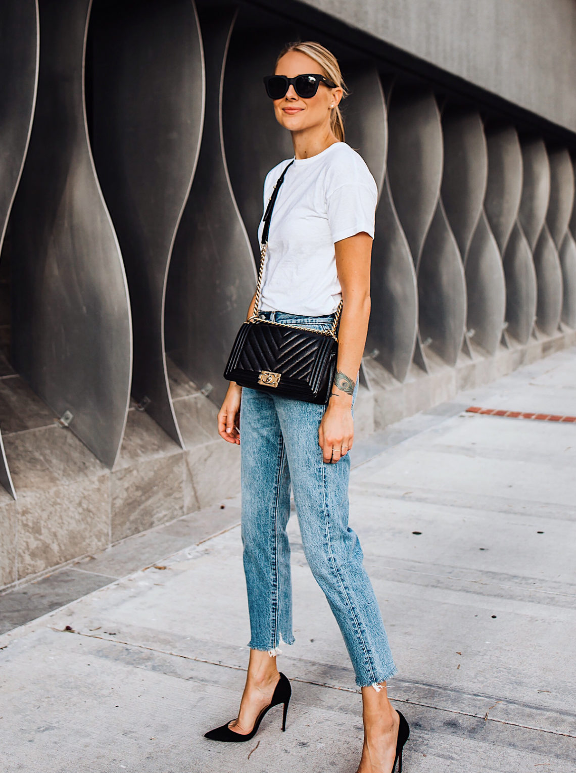 Blonde Woman Wearing Fashion Jackson White Tshirt Levis Wedgie Jeans Chanel Black Boy Bag Christian Louboutin Black Pumps Fashion Jackson San Diego Fashion Blogger Street Style