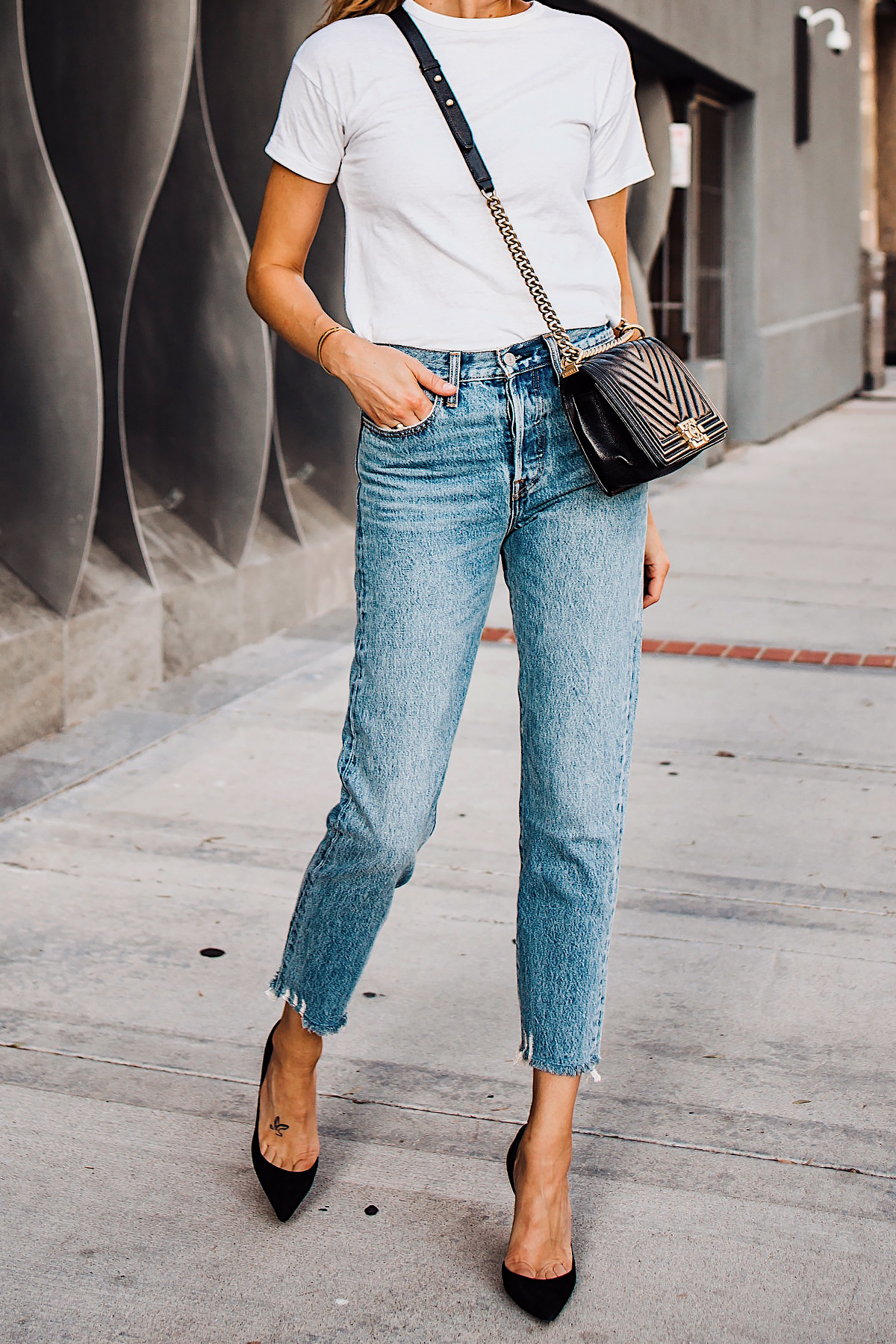Woman Wearing Fashion Jackson White Tshirt Levis Wedgie Jeans Chanel Black Boy Bag Christian Louboutin Black Pumps Fashion Jackson San Diego Fashion Blogger Street Style