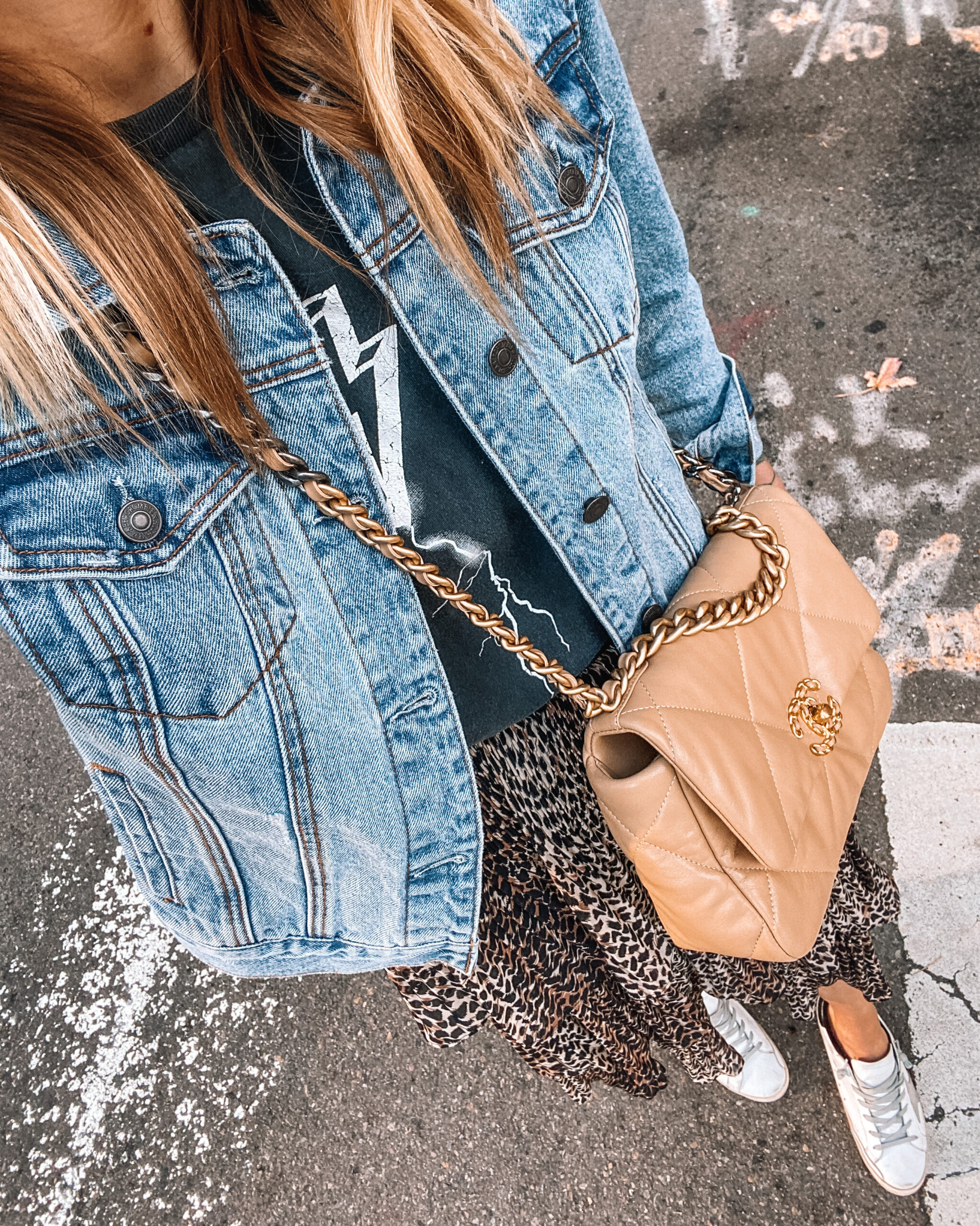 Fashion jackson Wearing denim jacket leopard midi skirt anine bing graphic tshirt golden goose sneakers