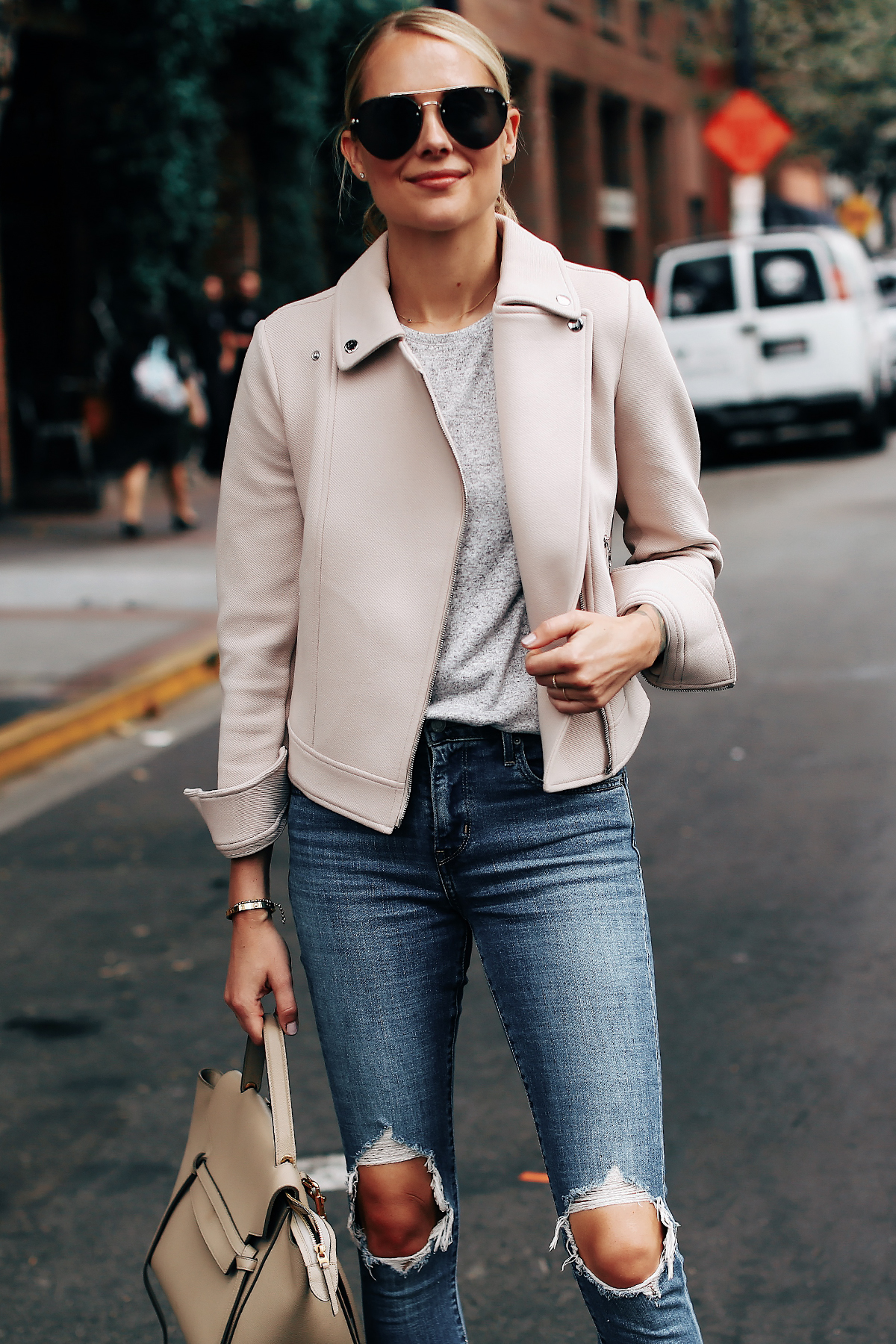 Blonde Woman Wearing Ann Taylor Blush Moto Jacket Grey Top Levis 721 Ripped Jeans Celine Mini Belt Bag Aviator Sunglasses Fashion Jackson San Diego Fashion Blogger Street Style