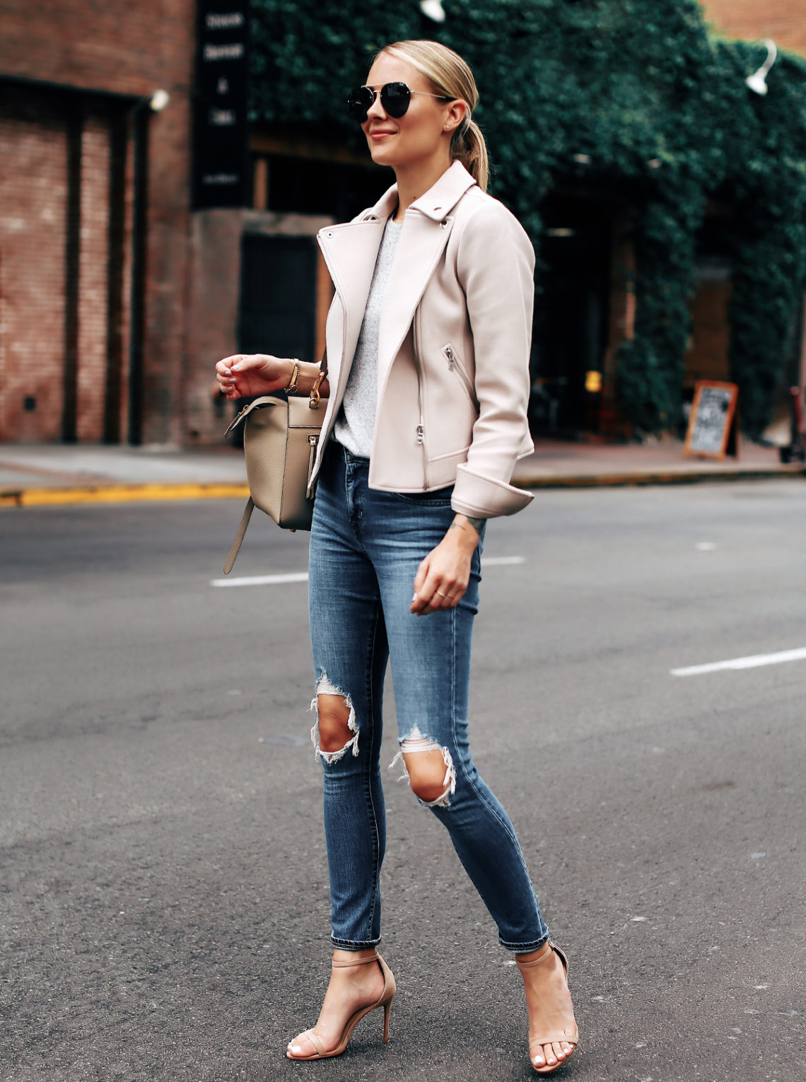 Blonde Woman Wearing Ann Taylor Blush Moto Jacket Grey Top Levis 721 Ripped Jeans Nude Ankle Strap Heels Aviator Sunglasses Fashion Jackson San Diego Fashion Blogger Street Style