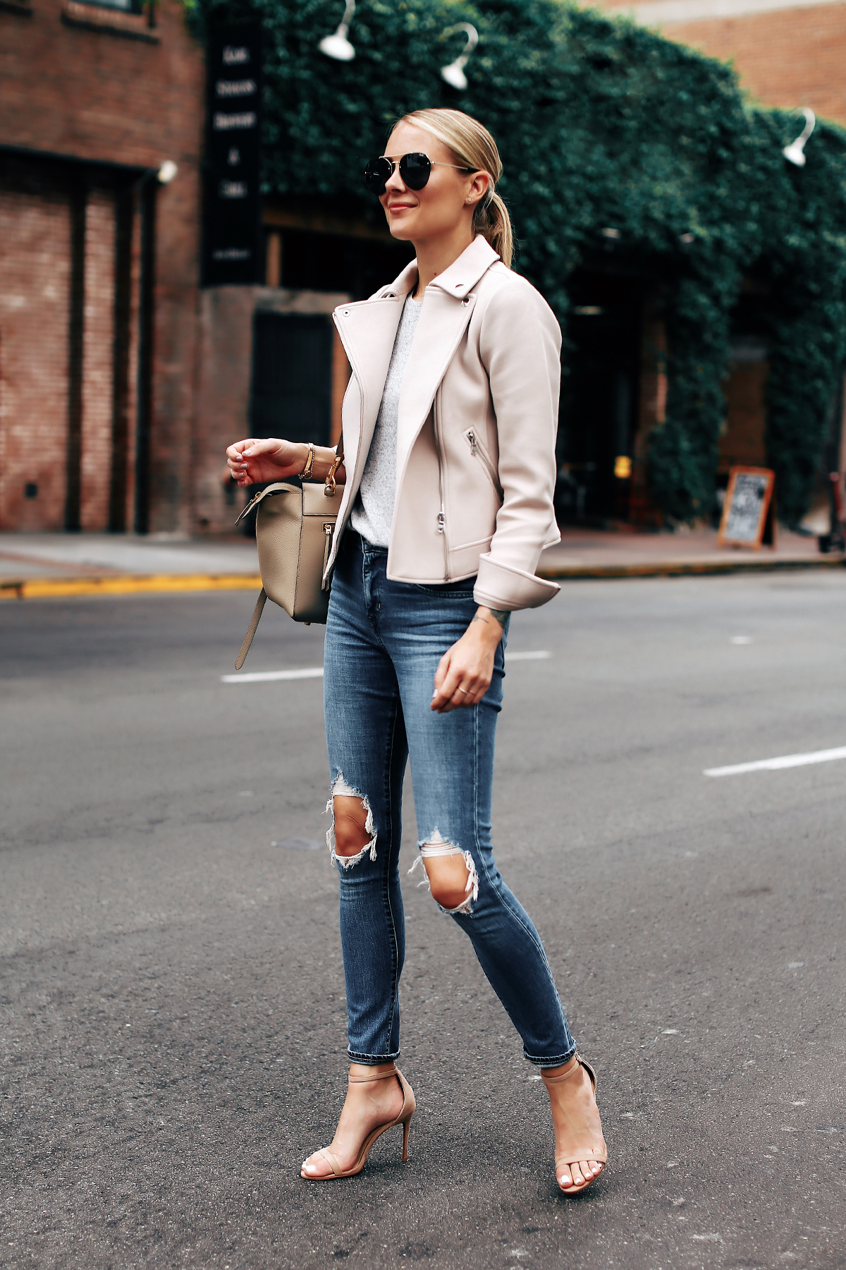 4c0477b01697c Blonde Woman Wearing Ann Taylor Blush Moto Jacket Grey Top Levis 721 Ripped  Jeans Nude Ankle