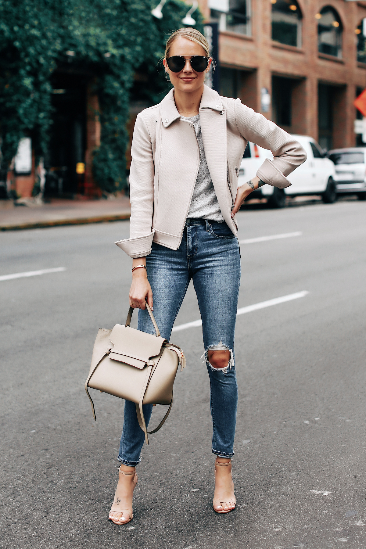 Blonde Woman Wearing Ann Taylor Blush Moto Jacket Grey Top Levis 721 Ripped Jeans Nude Ankle Strap Heels Celine Mini Belt Bag Aviator Sunglasses Fashion Jackson San Diego Fashion Blogger Street Style